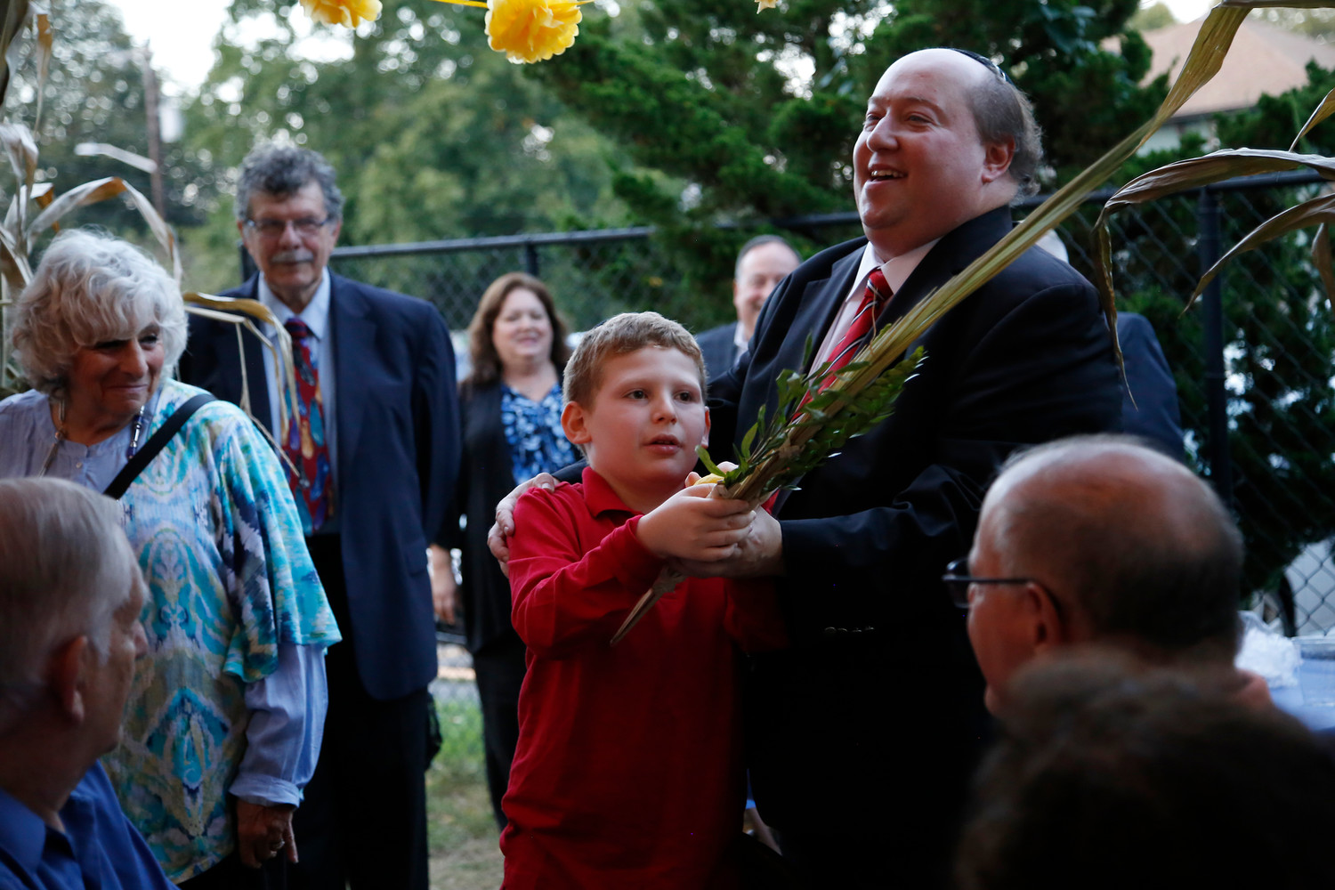 Ian Fishman helped Rabbi Mickey Baum shake the Lulav at Friday night's dinner in the sukkah, at Temple Beth Am of Bellmore and Merrick. The Herald was there to capture one of the most joyous evenings in the Jewish faith.
