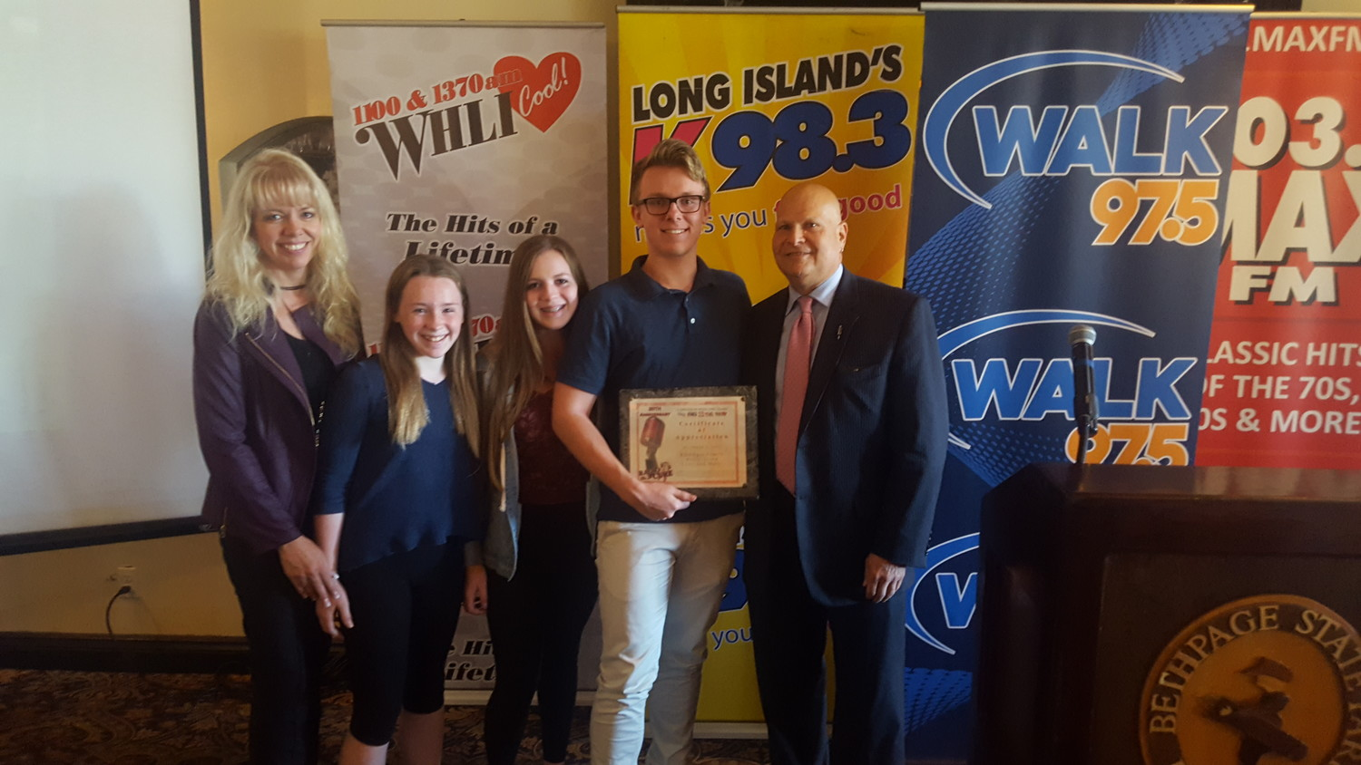 The Baldinger family was recognized for their fundraising efforts at Connoisseur Media Long Island's Oct. 3 luncheon in support of breast cancer awareness. Pictured here is Kerry Baldinger, left, her children Lexi, 14, Marci, 11, Jason, 17, and Stu Schrager, of Connoisseur Media Long Island.