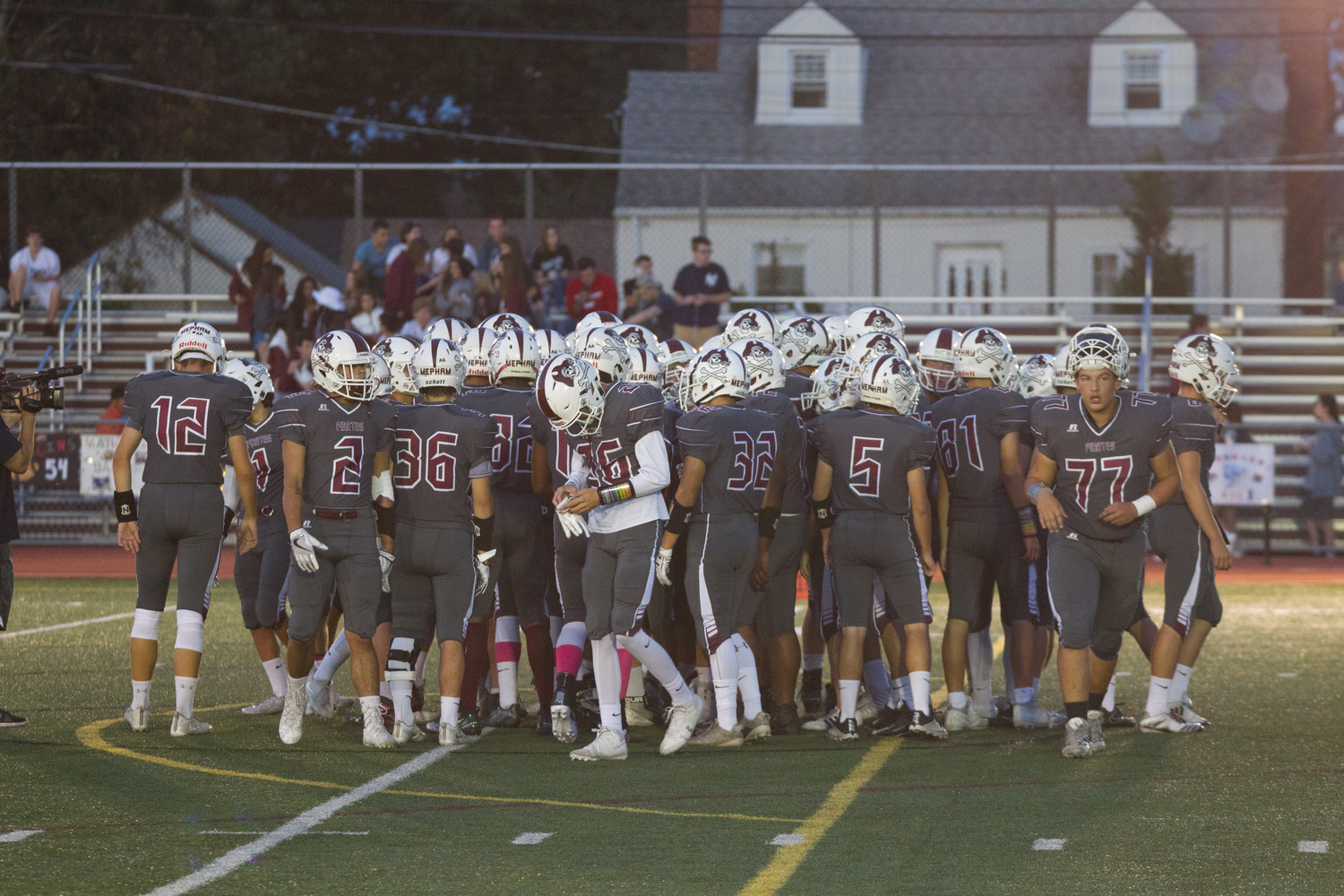 The Mepham Pirates huddled during their Friday night homecoming game against New Hyde Park Memorial.
