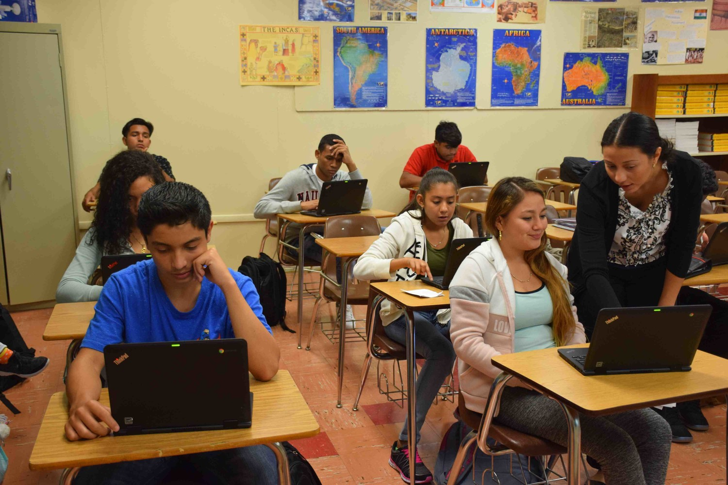 Freeport High School teachers are infusing traditional classroom teaching methods with new technologies now that all students have laptops.