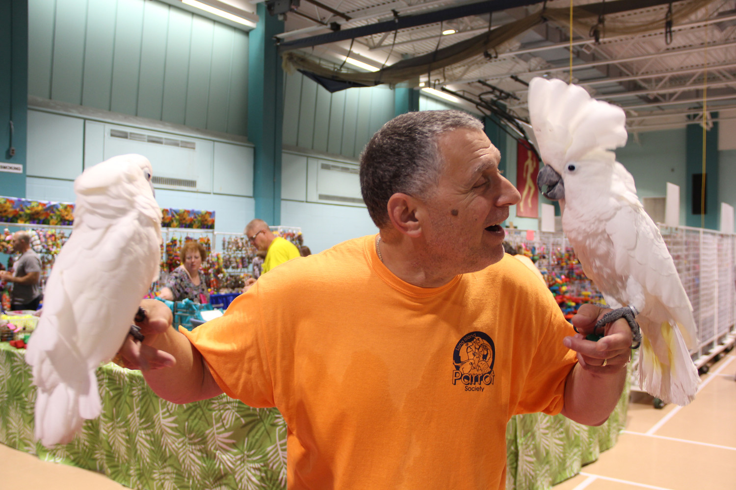 Robert Gross, of the Long Island Parrot Society got acquainted with Zachary, left, and another cockatoo named Romeo.