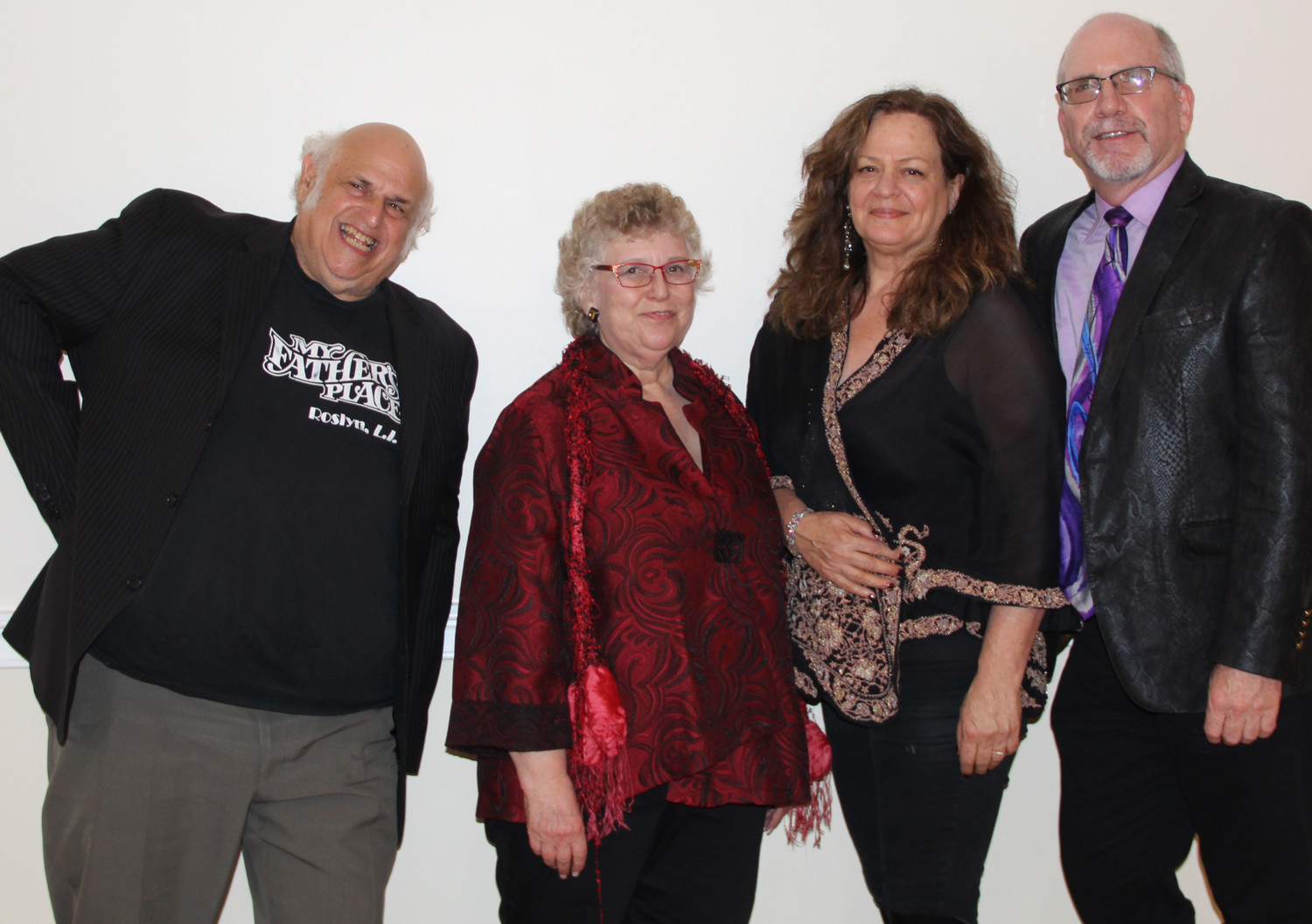 "Award winners Michael ""Eppy"" Epstein, Jude Schanzer and Caroline Doctorow stood with Long Island Arts Council Executive Director Laurence Dresner at the ARTY Party ceremony on Oct. 8."