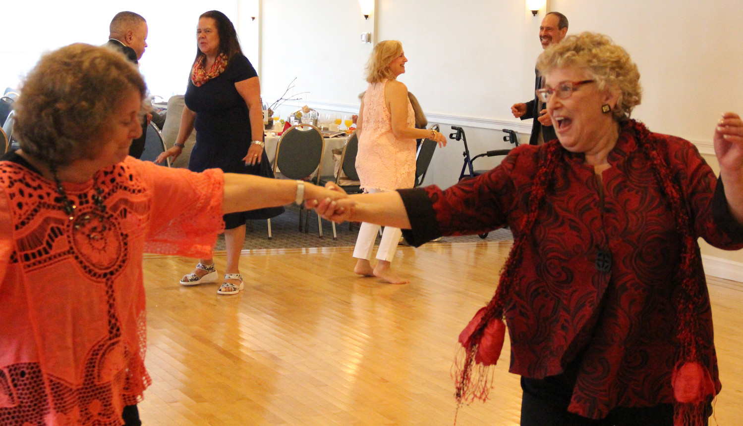 Linda Soldo, the East Meadow Public Library's newsletter editor, danced with this year's Arts Recognition Tribute Award winner Jude Schanzer on Oct. 8.