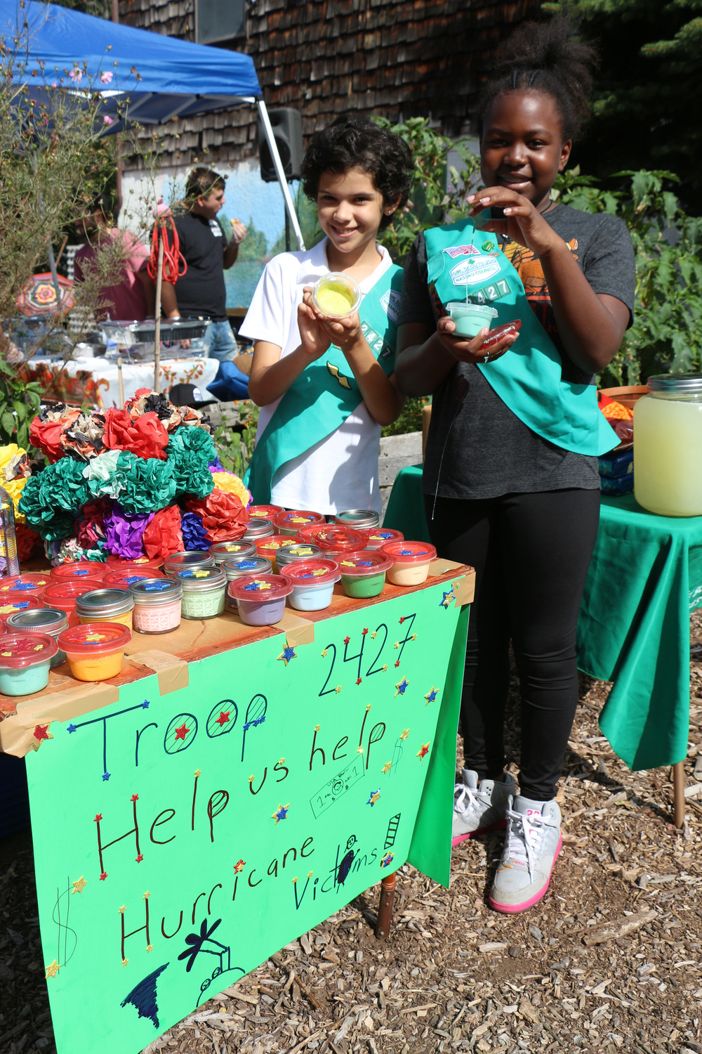 "Baldwin Girl Scout Troop 2427 sold homemade ""GOO"".  Money raised from sales went to the victims of the recent hurricanes.  Alessandra Sage, 10, and Nia Maco, 11, demonstrated how the Goo works."