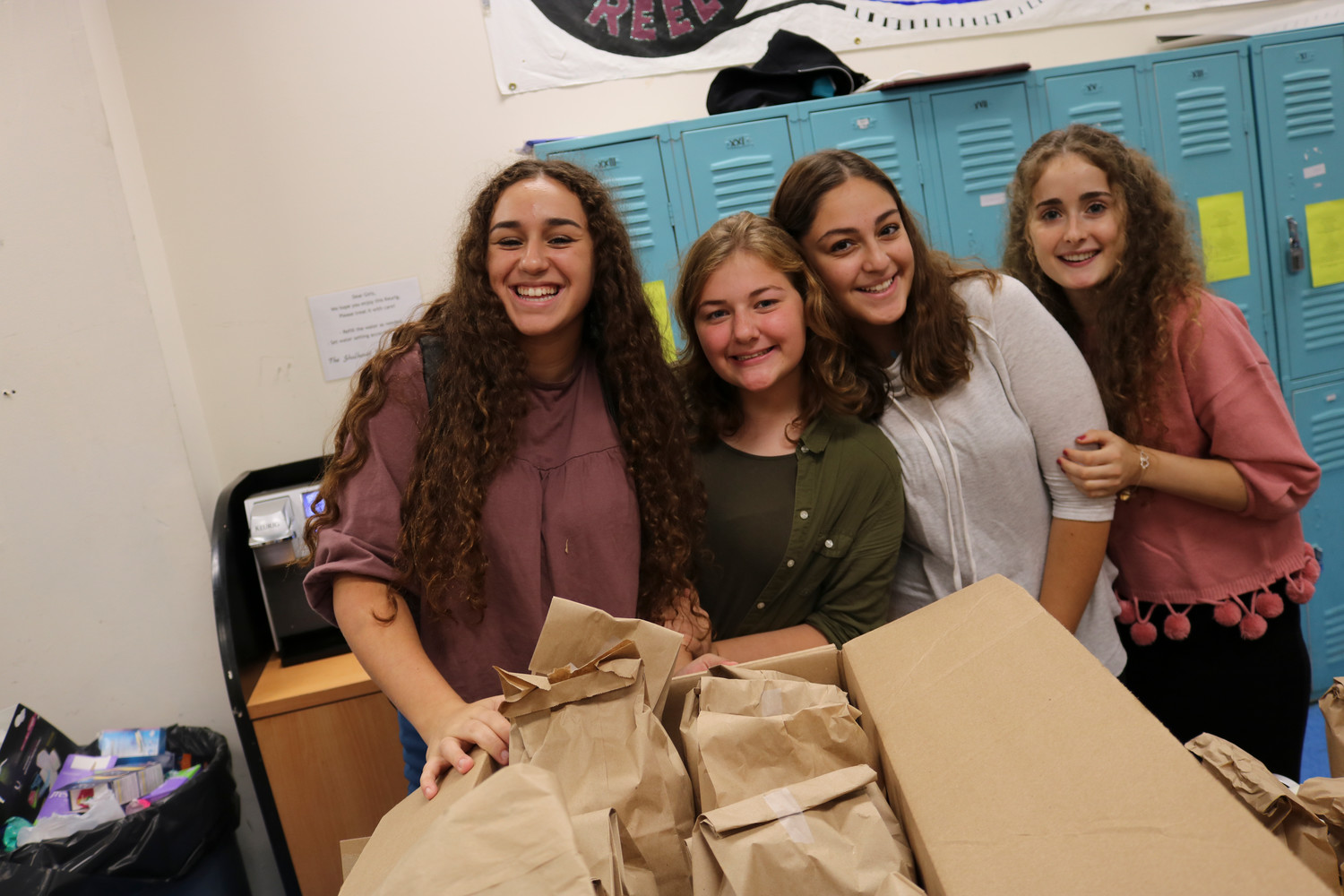 Midreshet Shalhevet High School students donated supplies to women's shelters. From left were Rachelli Klein of Lawrence, Hadassah Fertig of Woodmere, Shana Schapira of Brooklyn and Hannah Zerbib of Lawrence.
