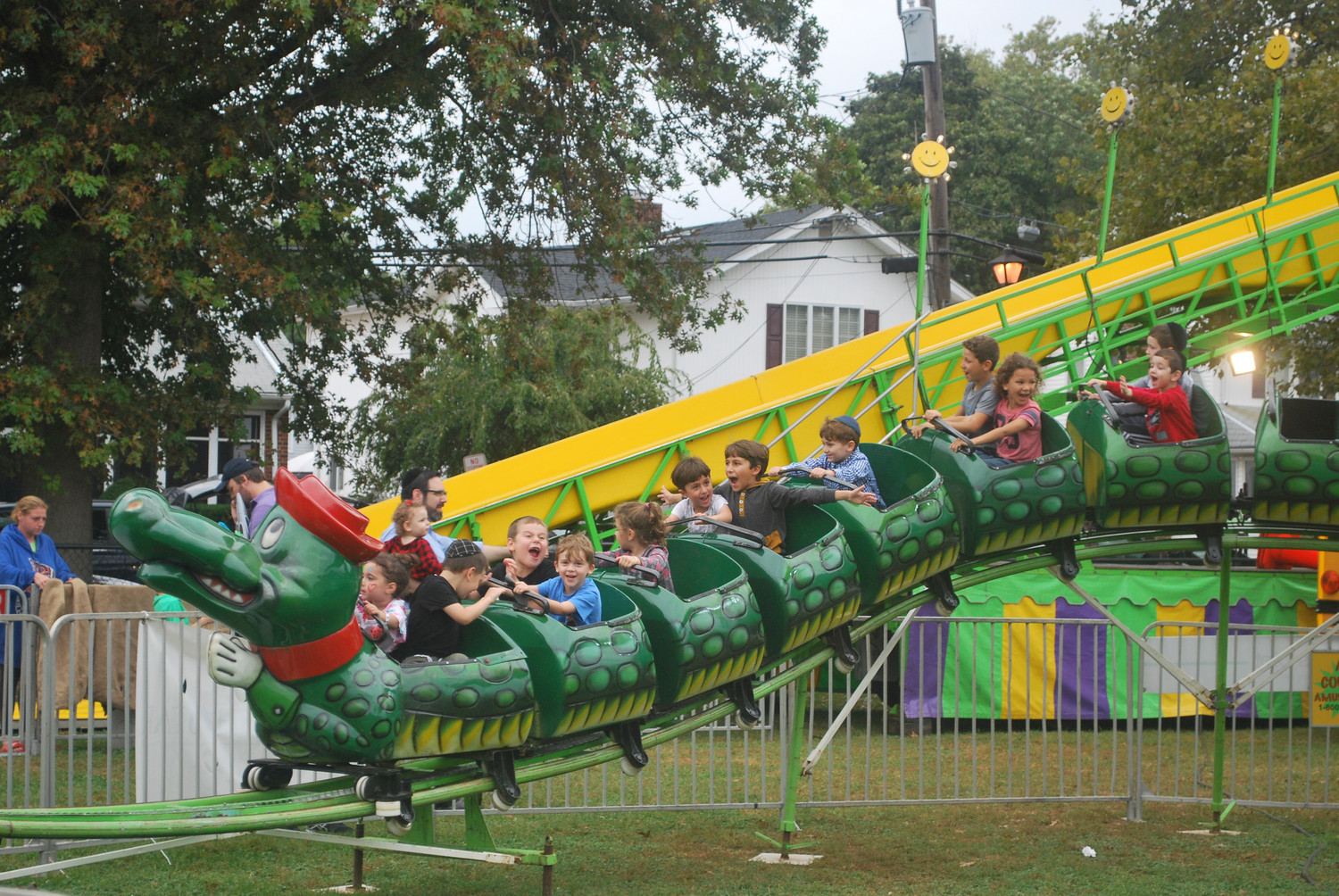 The Go-Gator ride at the Community Chest South Shore fair at Andrew J. Parise Cedarhurst Park provided thrills for several children last Sunday.