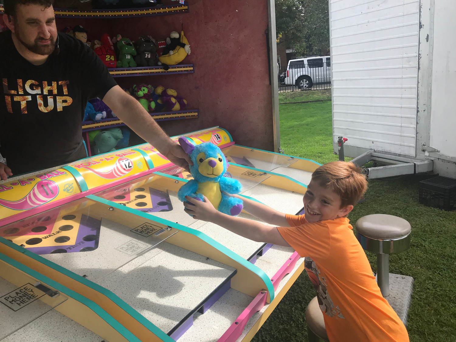 Thomas Murgolo, 9, lit up the Roll-A-Ball game at the Community Chest South Shore fair last Saturday, and walked away with a prize.