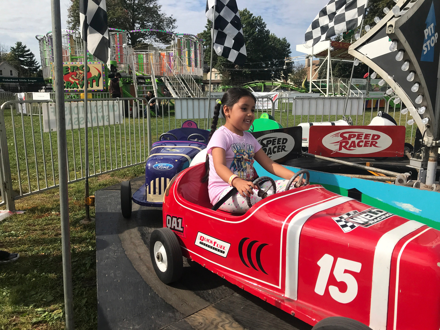 Danica Patrick has nothing on Shanty Vasquez, 6, as she made like Speed Racer on the car ride at the fair on Oct. 7.