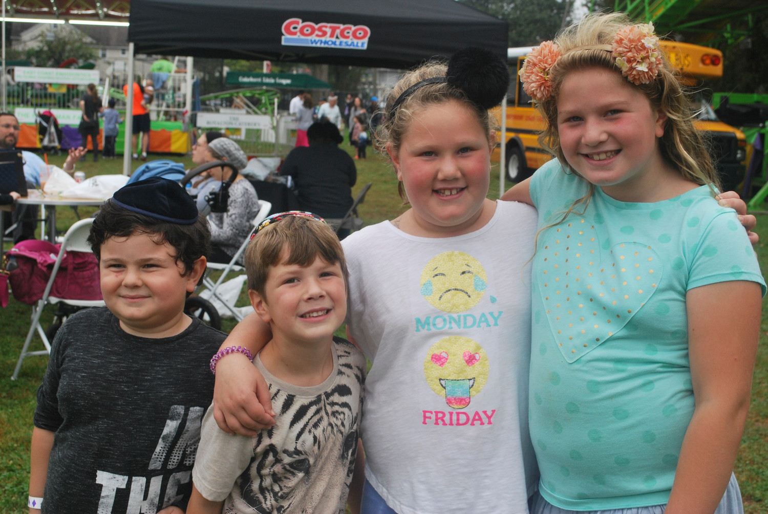 The Community Chest fair brought family and friends from Cedarhurst together for fun on Oct. 8. From left were Solly Labell, 5, and the Wechters: Sammy, 5, Lilly, 7, and Rosie, 9.