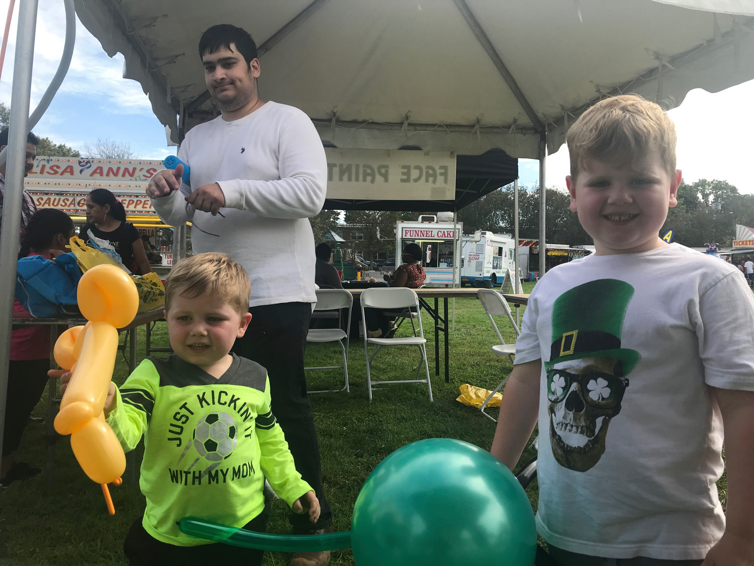The brothers Labasi — Nicholas, 3, and Santino, 4, — had fun with balloons at the fair on Oct. 7.