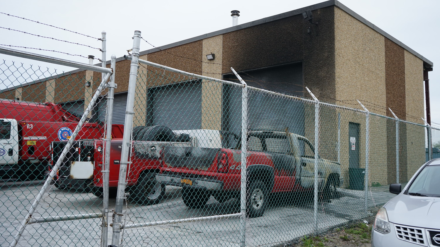 A May 4 photo showing damage done by an April 28 fire at Oceanside Sanitation District No. 7's Mott Street headquarters to two pickup trucks. The Nassau County fire marshal's office confirmed on Oct. 5 that the fire was set intentionally.