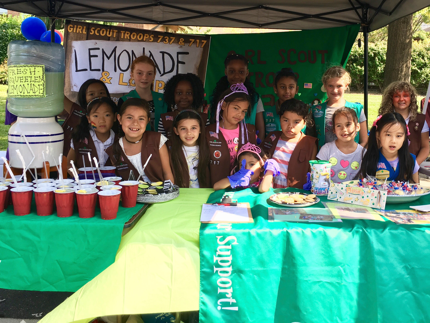 More than $700 was raised by Girl Scout troops 717 and 737 as they sold homemade chocolate lollipops and homemade fresh-squeezed lemonade at Arts Below Sunrise last month. From left in front were Mischa Zhang, Kaelyn Schaefer, Isabella McKenna, Sophia Balmores, Anna Balmores, Valentina Urena, Cecilia DiFrancisco and Julia Lu. From left in back were Allesandra Estioko Heather McHale, Aaliyah Ojikutu, Almeerah Ojikutu, Anjali Patel, Stella Fratti and Johanna Zack.