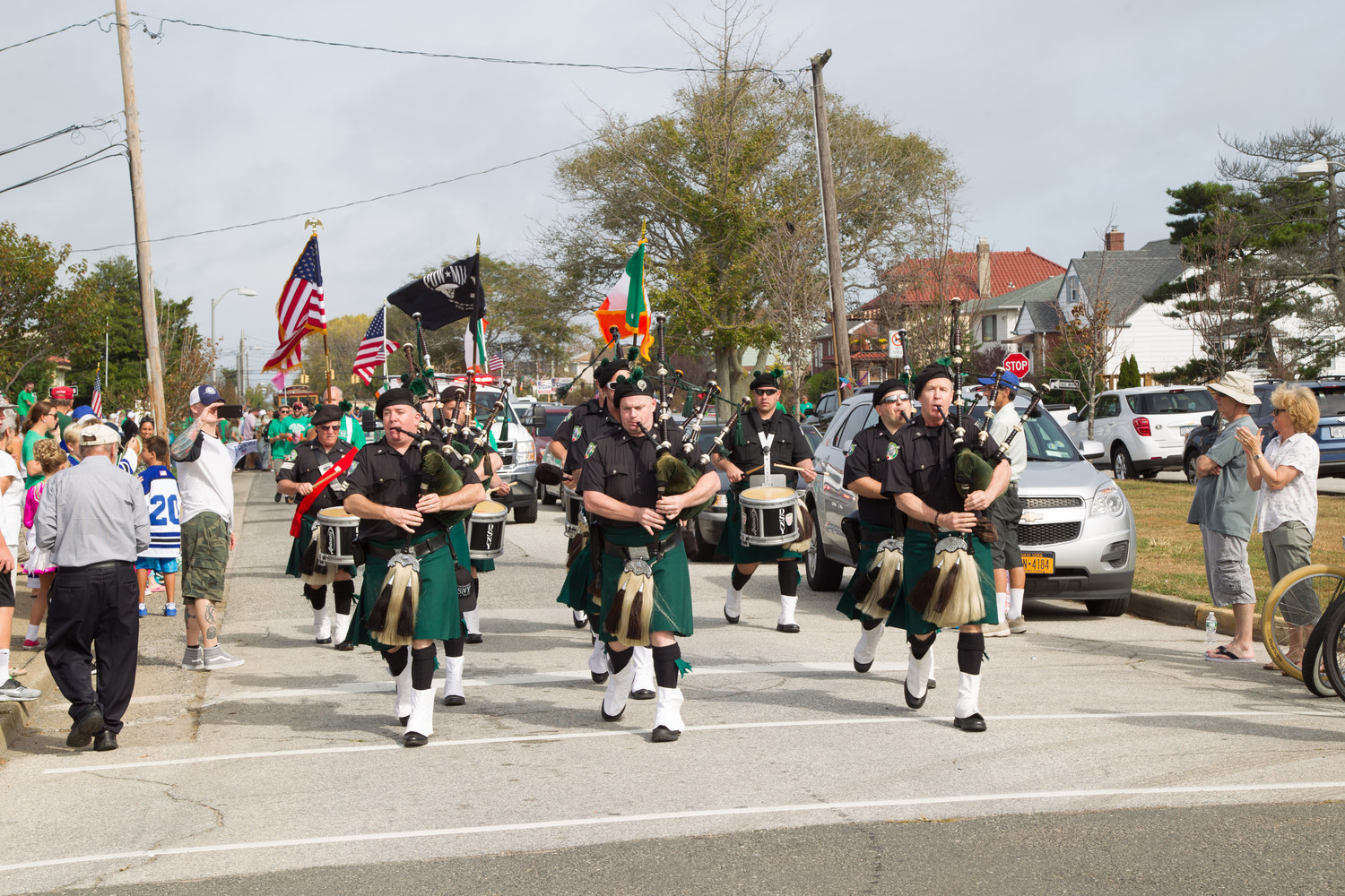 The New York City Department of Sanitation Emerald Society Pipes and Drums played the bagpipes in the parade on Saturday morning.