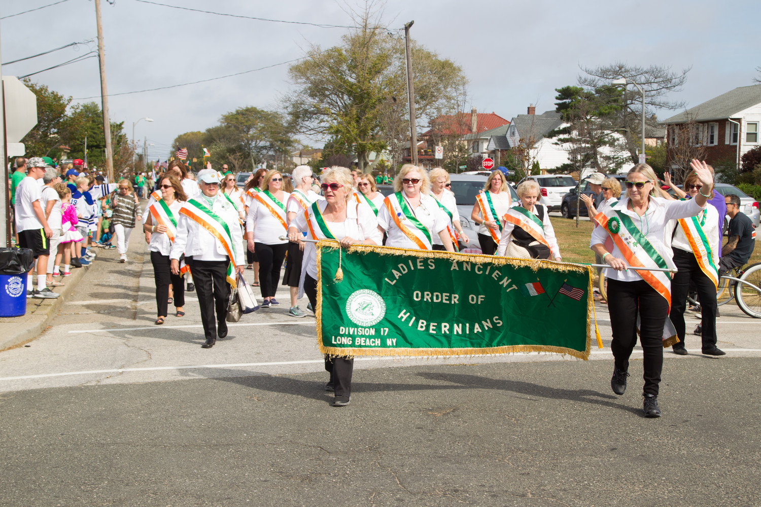 The Ladies Ancient Order of Hibernians Division 17 of Long Beach waved to onlookers as they walked down West Beech Street.