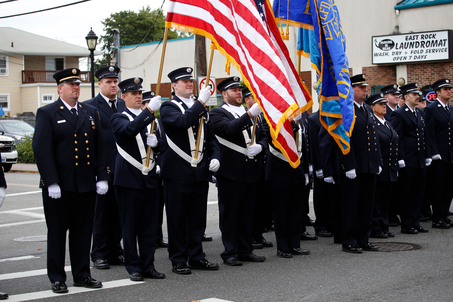 Members of the Lynbrook Fire Department lined the street at the beginning and the end of William Hendrick's funeral Mass.
