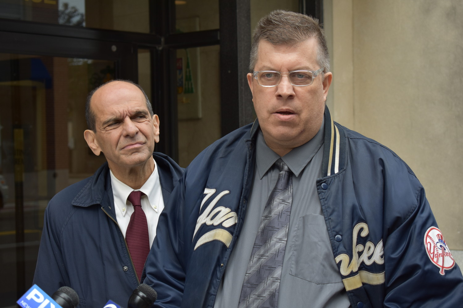 Thomas McGarvey, right, who grew up in Franklin Square, alleged that a priest sexually abused him at St. Catherine of Sienna Church over eight years at a news conference outside the Diocese of Rockville Centre's headquarters on Monday. Boston attorney Mitchell Garabedian, left, who has handled hundreds of sexual abuse cases, is representing him.