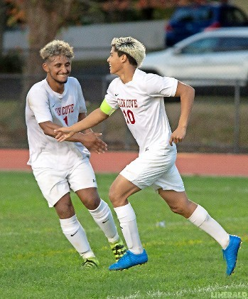 Glen Cove's Jelson Bonilla, right, and Edwin Yanes celebrate after Bonilla scored in a 2-2 draw against Lawrence on Oct. 10.