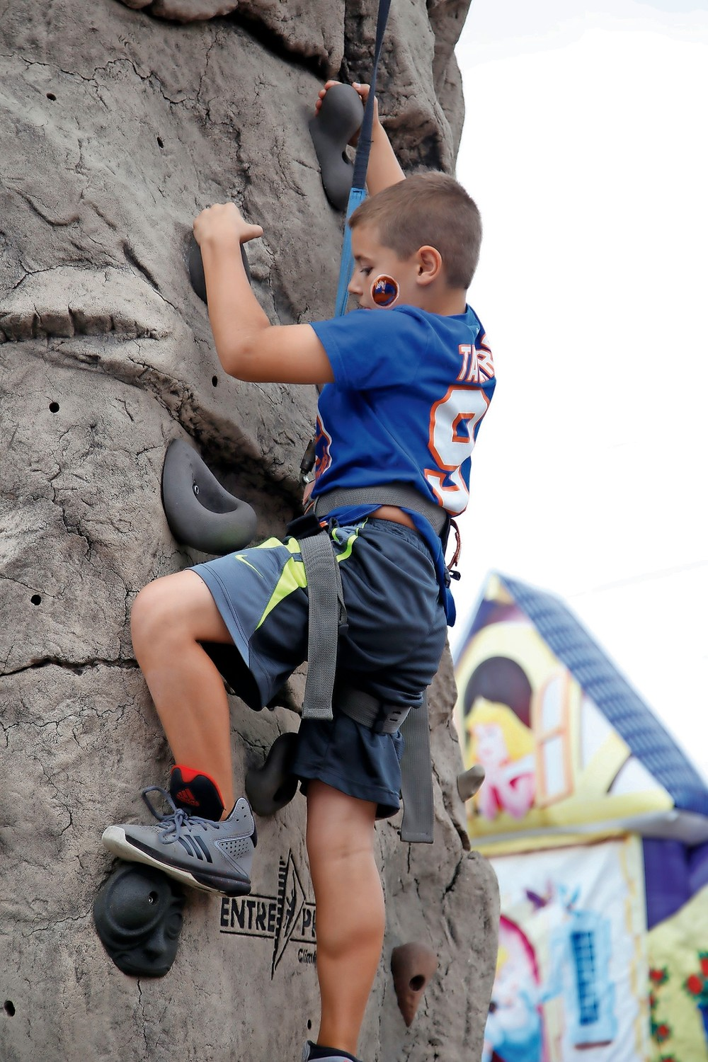 Chase Sattali, 10, made it to the top of the climbing wall at Malverne's annual Fall Festival and Classic Car Show.