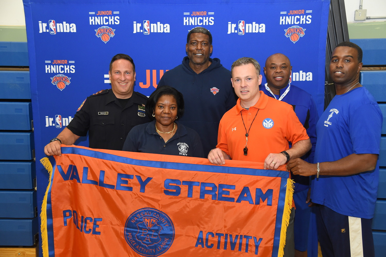 Police Activity League coaches and directors Chris Innace, Annette Gray-Thom, Steve Thom and Ramsey Jenkins applied for the Papa John's Pizza Party and won a two-hour basketball clinic with Larry Johnson, third from left, and Knicks' Director of Fan Experience Brendan Callahan, fourth from left.