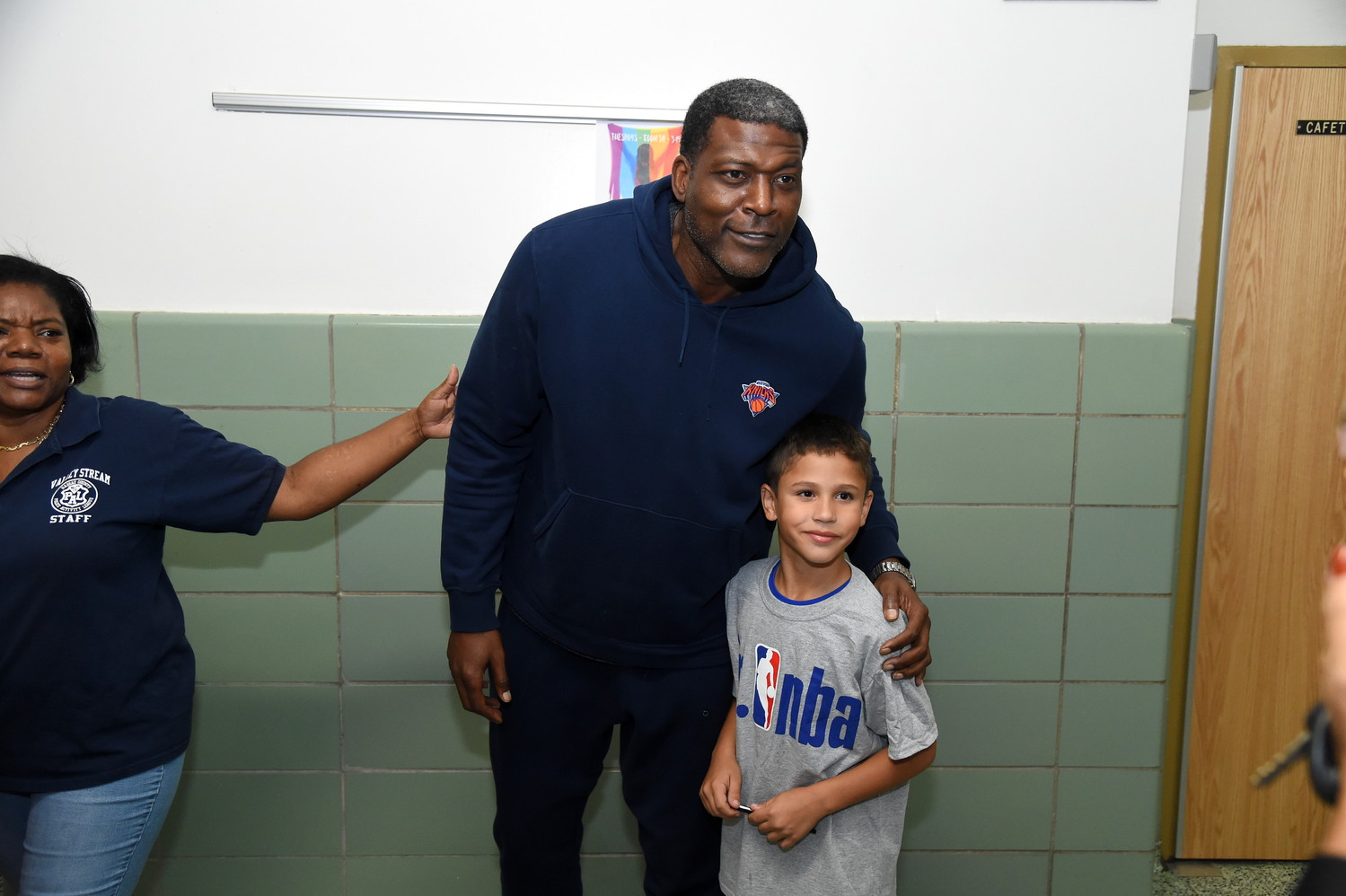 After the basketball clinic was over, kids such as 9-year-old Anthony Cantara lined up to take pictures with Larry Johnson.