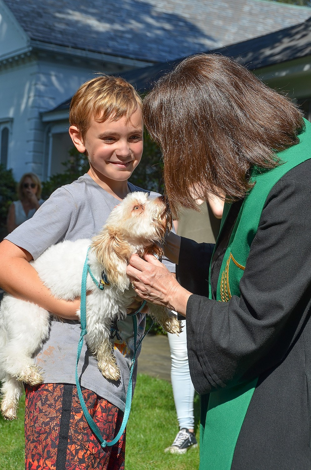 Robert Ross was happy to have his dog blessed by Rev. Vicky Eastland at Brookville Church's Blessing of the Animals.