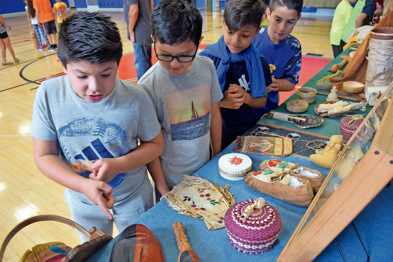Parkway Elementary School fourth-graders examined American Indian tools during an in-school field trip led by Journeys into American Indian Territory.