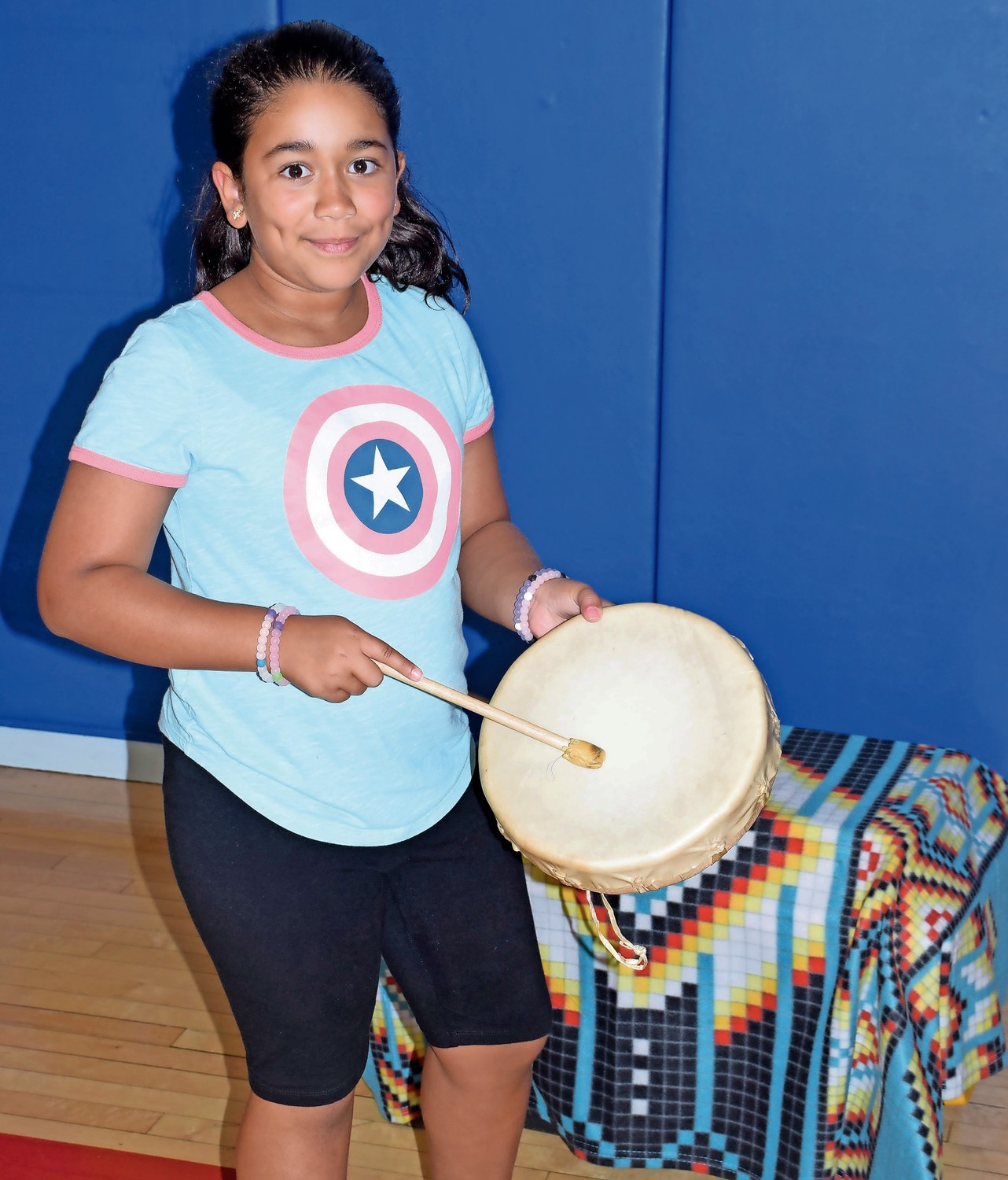 Parkway Elementary School fourth-grader Brianna Almanzar created music by beating a drum.