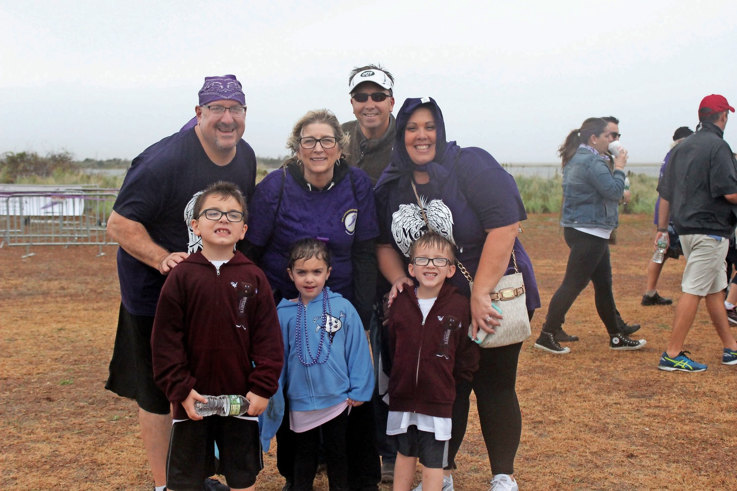 The Iacopelli and Raucci families made the best of rainy conditions at the Long Island Pancreatic Cancer Research Walk at Jones Beach State Park in Wantagh on Oct. 8. The Lustgarten Foundation sponsored the event at Field 5.