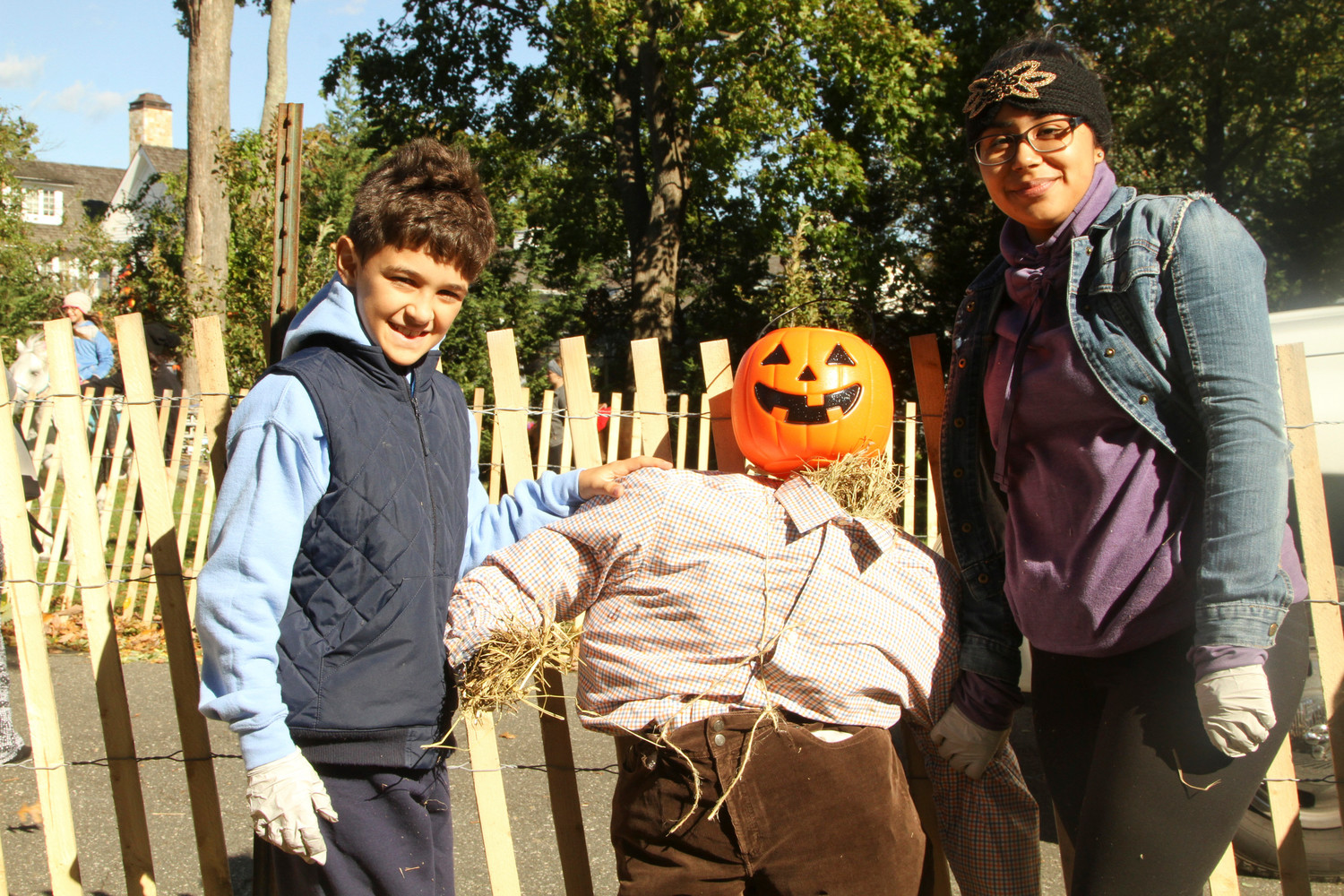 Alex Nieves and Astrid Menjibar collaborated on putting together a scarecrow at last year's fair.