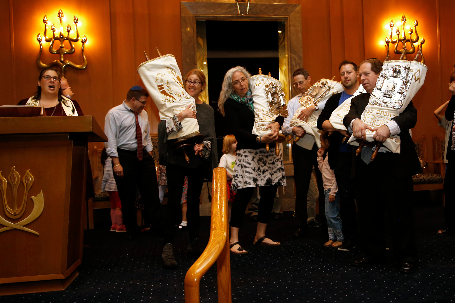 Congregants of Central Synagogue held the Torah scrolls.