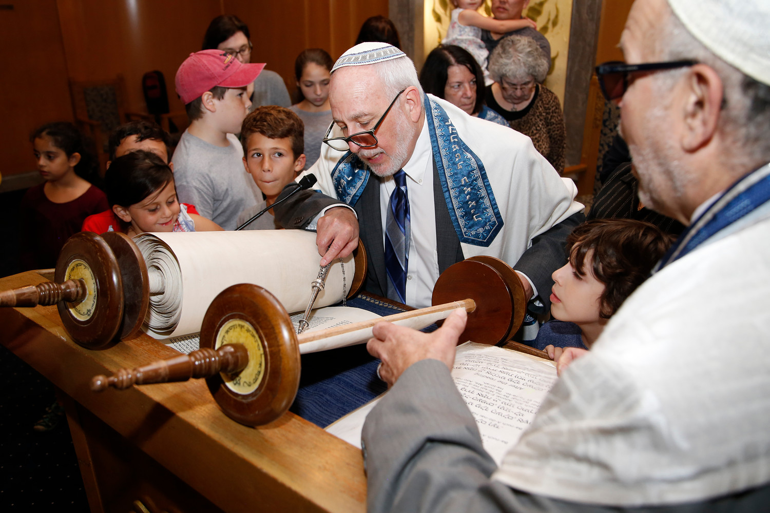 Rabbi Elliot Skiddell and Rabbi Marc Gruber, right, gathered the children and read from the Torah during a Simchat Torah service on Oct. 11.