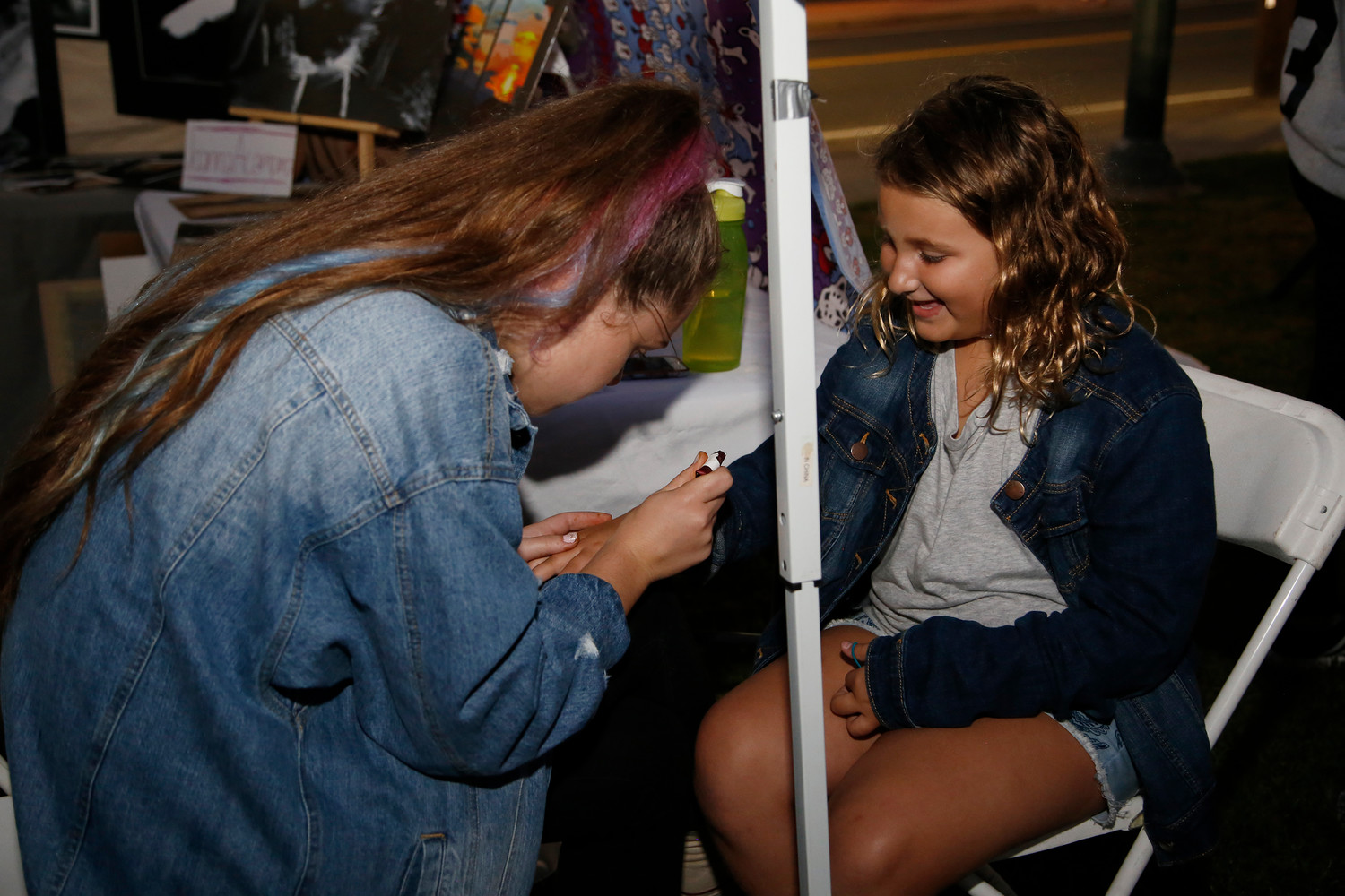 East Rockaway Junior-Senior High School senior Joanna Acampora gave Jenna Quaranto, 8, a tattoo.