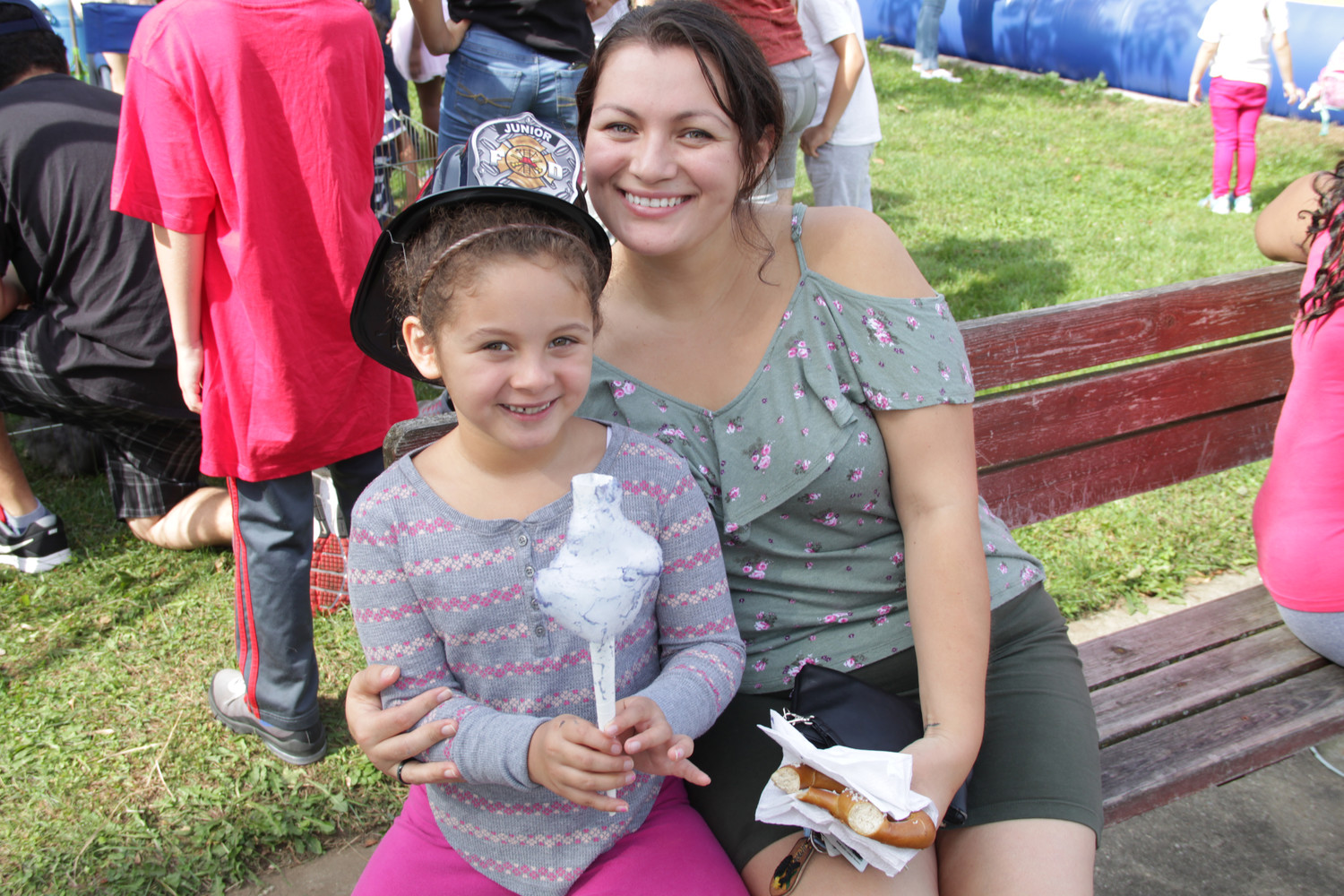 Karissa Lazo, 7, and her mom Yolonda Lazo enjoyed cotton candy and a soft pretzel during the Freeport Memorial Library Fall Festival on Oct. 7.