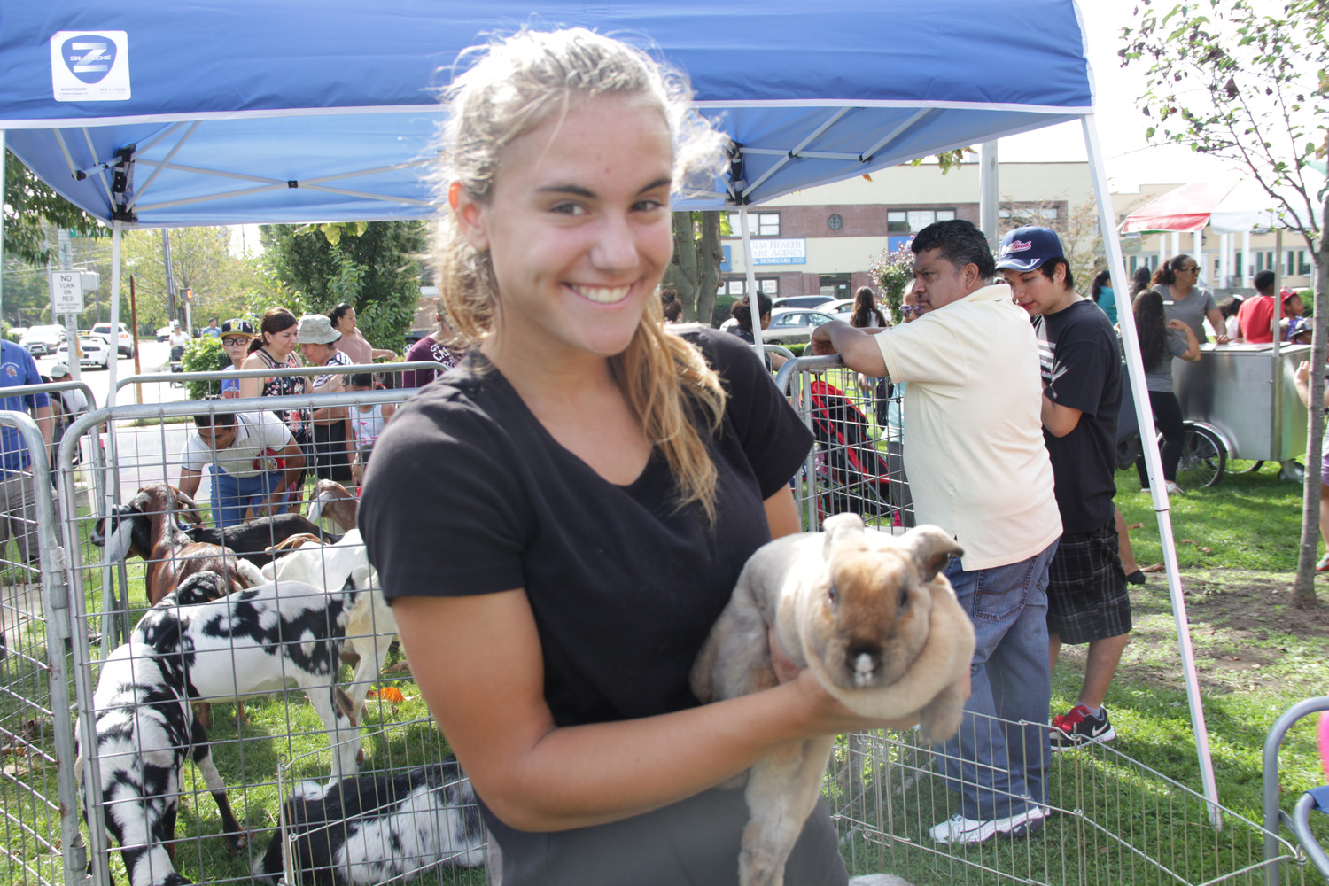 Library volunteer Kailyn Reynolds, 16, looked after the bunnies and chickens during the festival's petting zoo.