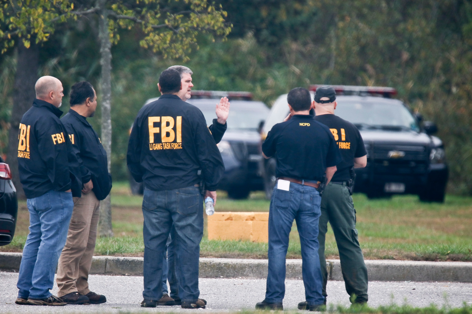FBI agents focused their search for human remains on a wooded area in the center of Cow Meadow Park in Freeport.