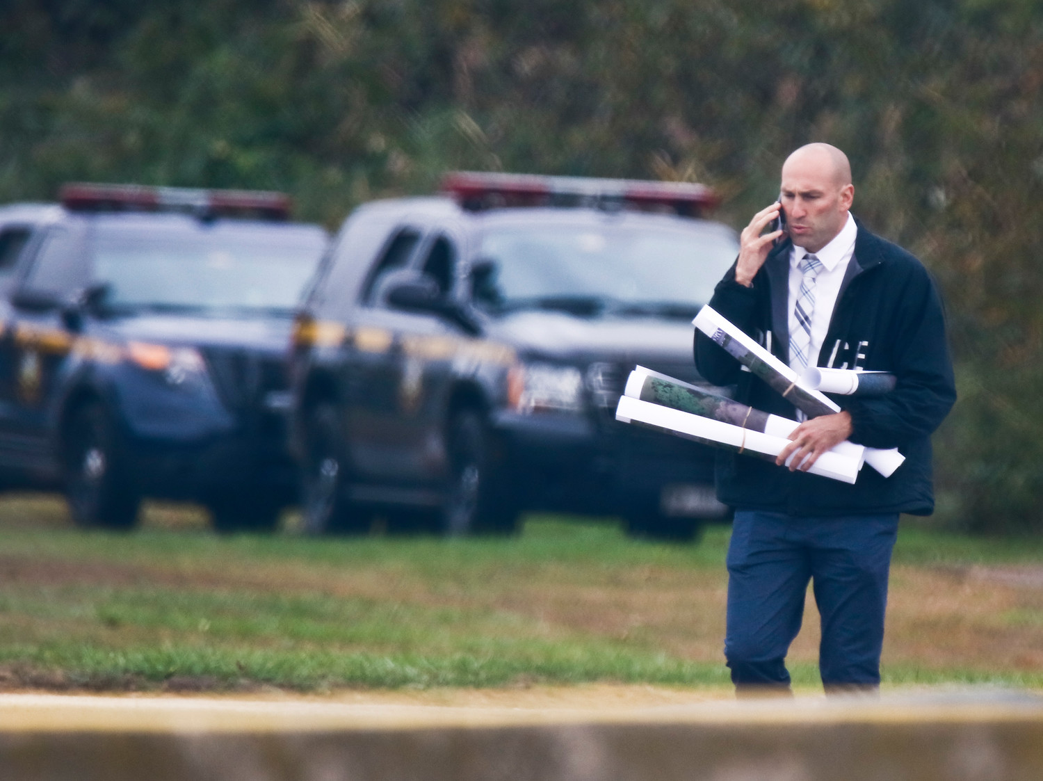 Agents on the scene used an assortment of maps to search the area.
