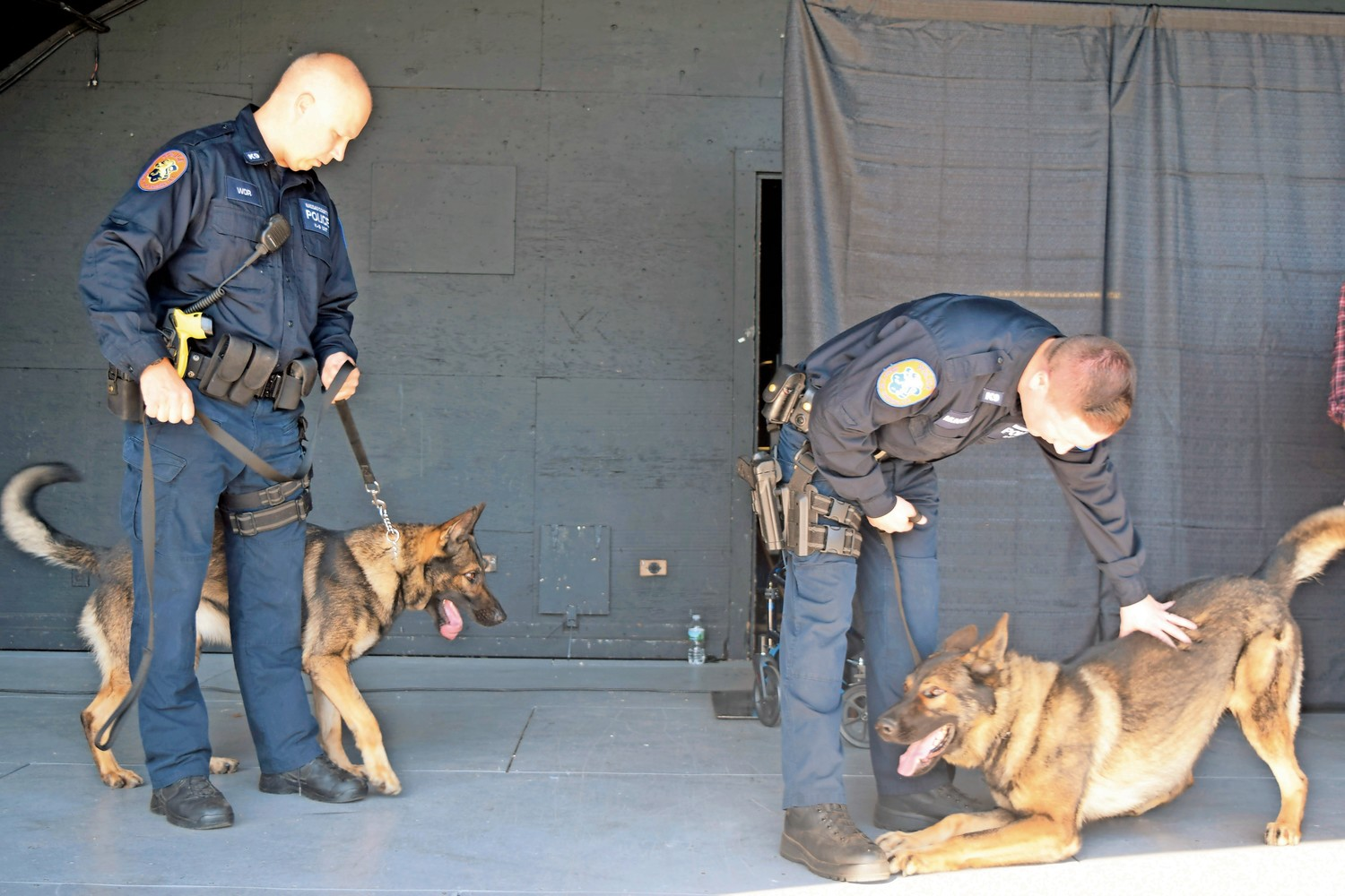 Canine Unit officer Adam Wor, left, with his dog, Blitz, and Officer Kevin Munnelly and his dog, Doyle.