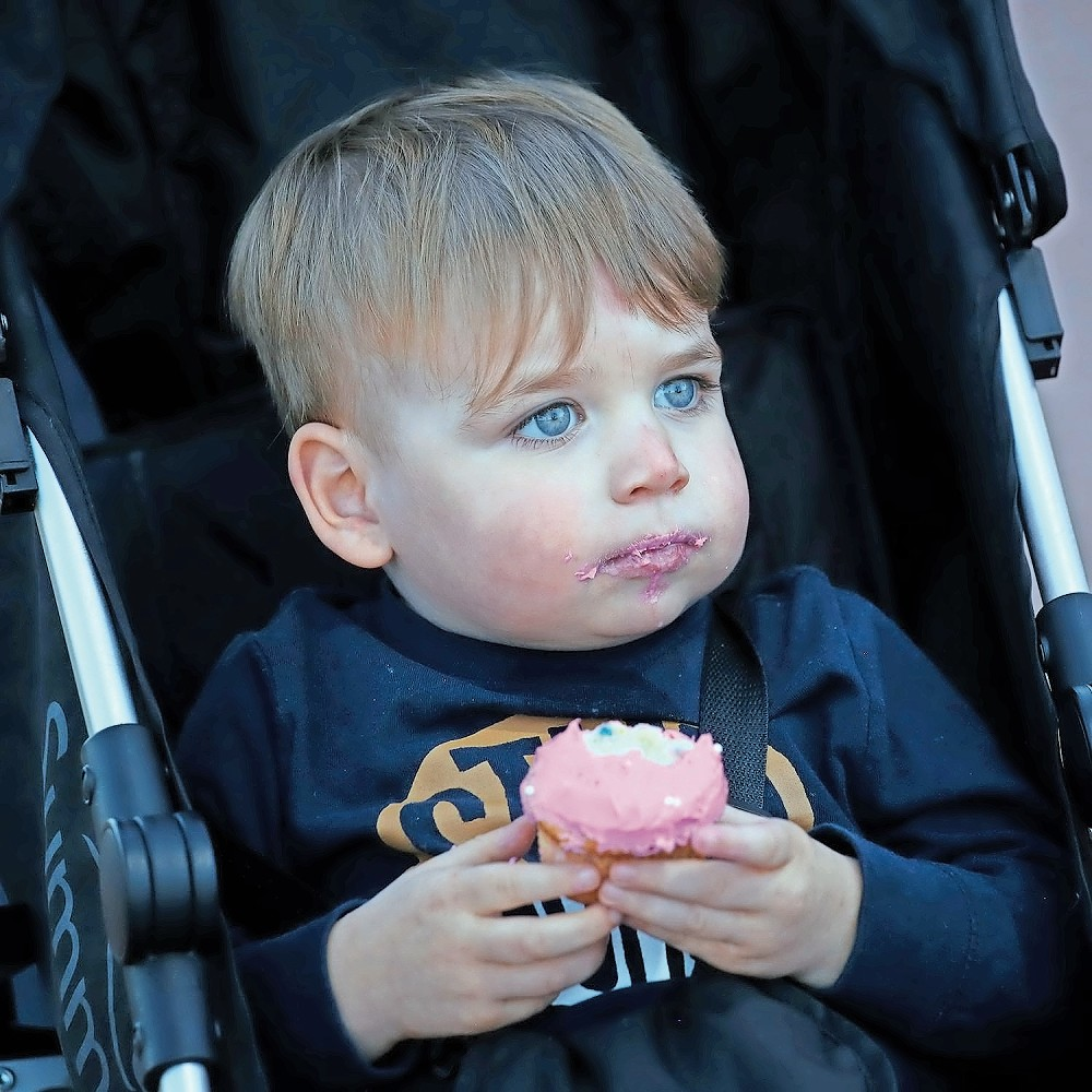 Lucas Lyons, 2, nibbled on a pink cupcake.