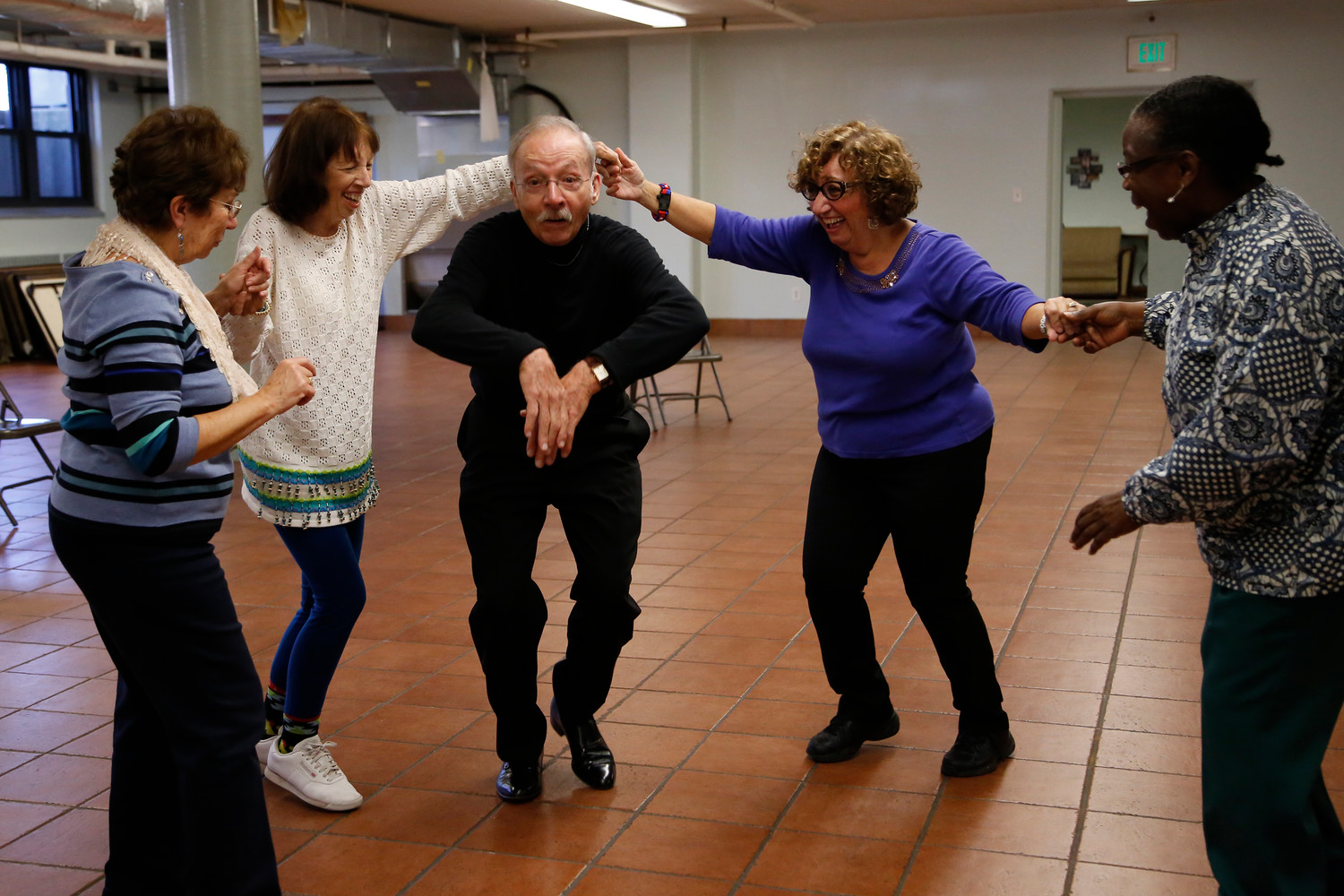 Guy Ferrara clowned around with, from left, Rose Sciacca, Valerie Esposito, Lilly Gicala and Nkromah Abernethy in October at Blessed Sacrament Church. Ferrara offered free salsa lessons for seniors in an effort to attract new members and rejuvenate the New and Vibrant Over 50s Club, which was at risk of folding.