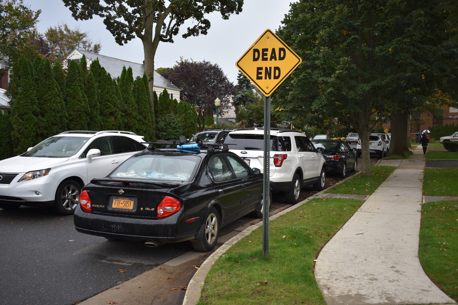 Bradford Court becomes congested as staff members and parents park and enter Hewitt Elementary School through a gate at the end of the dead-end street.