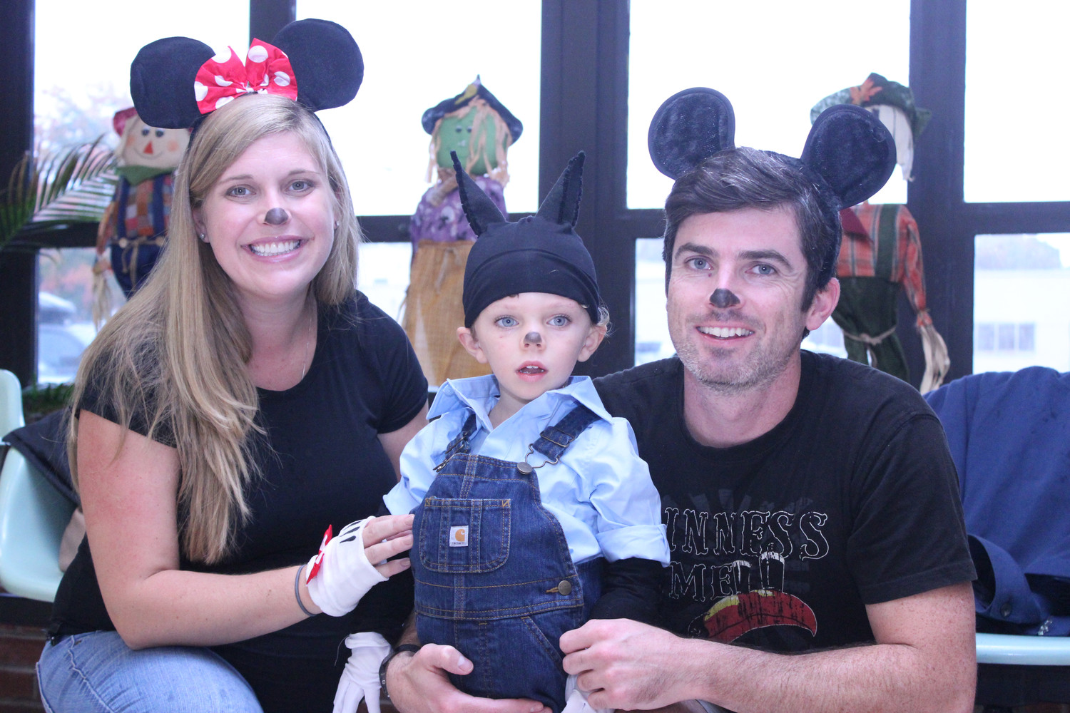 Despite the annual Ragamuffin Parade being cancelled, the Holland family, from left, including Monica, Daniel, 2, and Donal, enjoyed a Halloween party at the Rockville Centre Recreation Center on Oct. 29.