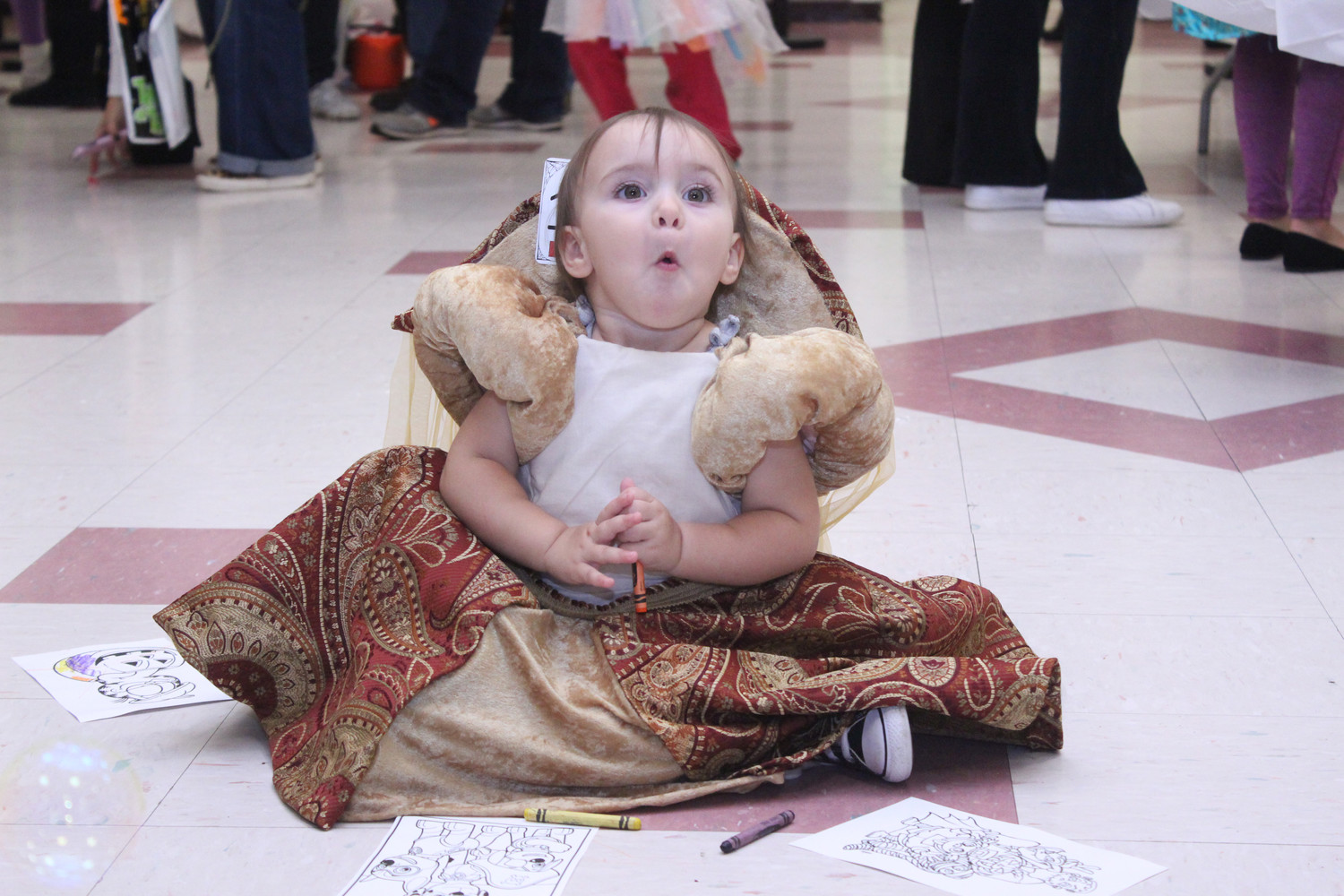 Imogene Caron, 17 months old, dressed as Queen Elizabeth I at the Halloween gathering.