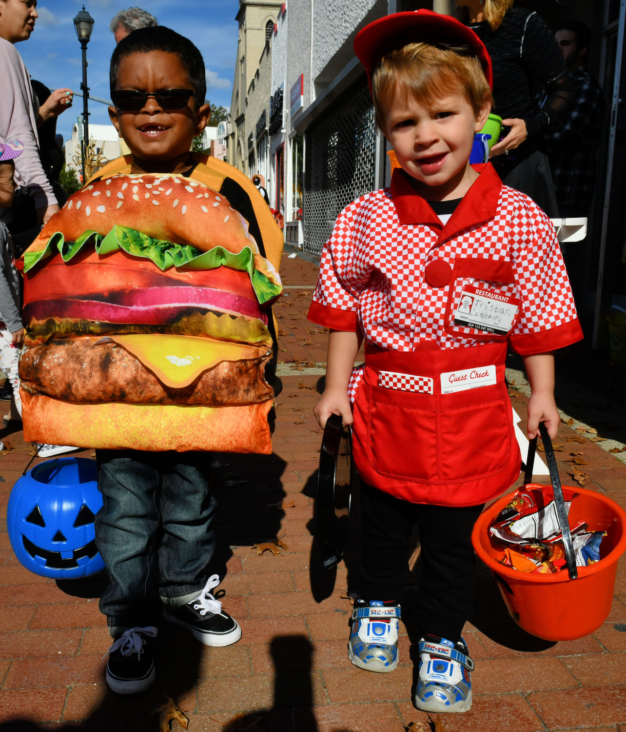 MJ Hopkins and Tristan Connelly dressed up as the cutest cheeseburger and waiter in town for the BID's Halloween parade.