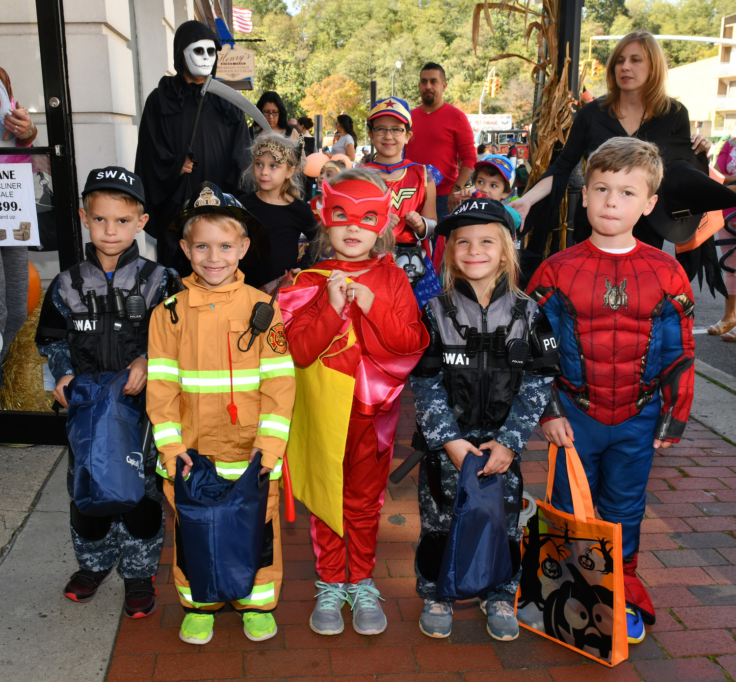 A group of young heroes discovered that it was fun to dress up as both real and comic book heroes for Halloween.