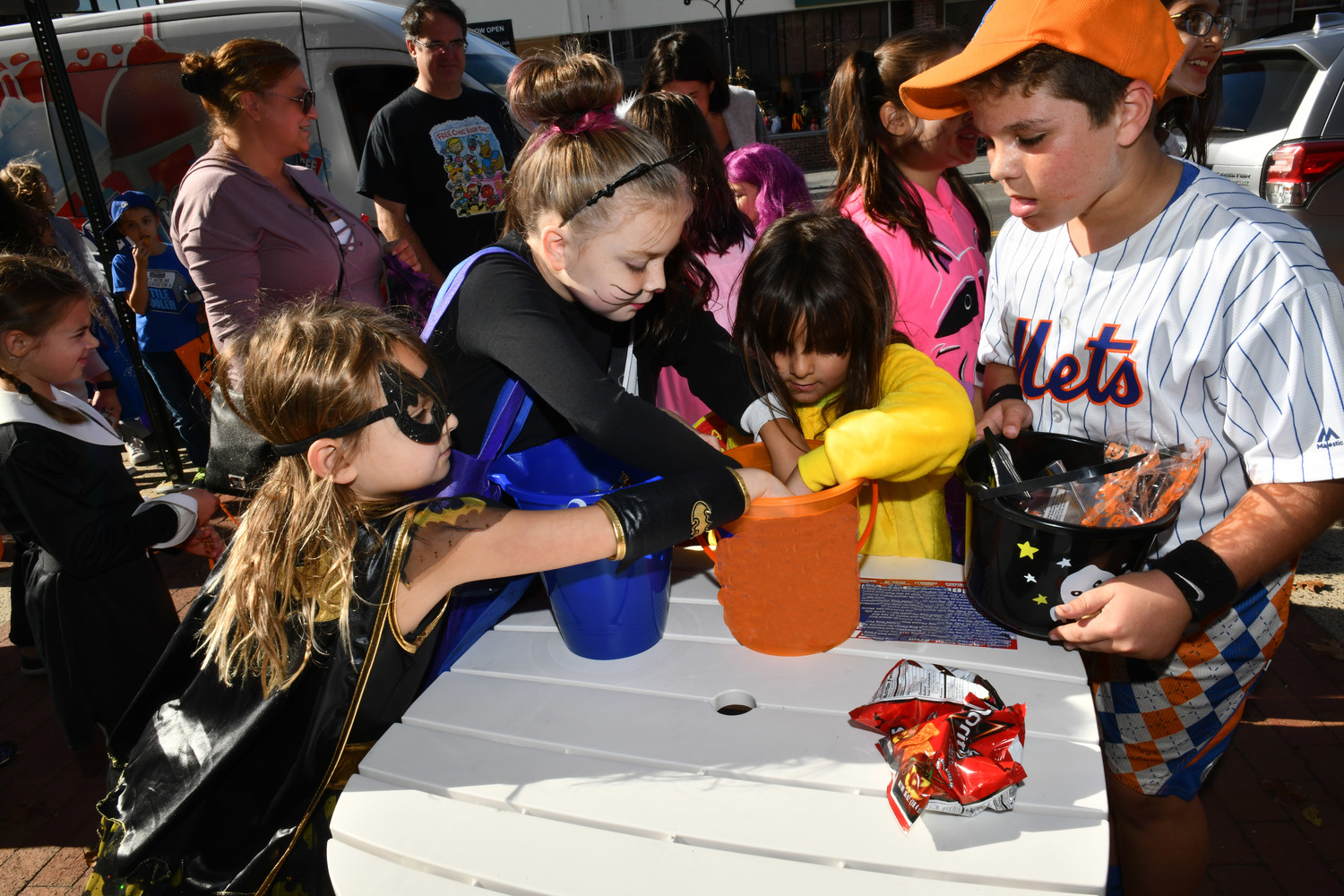 Kids dug into some free candy after trick-or-treating at the stores in downtown Glen Cove.