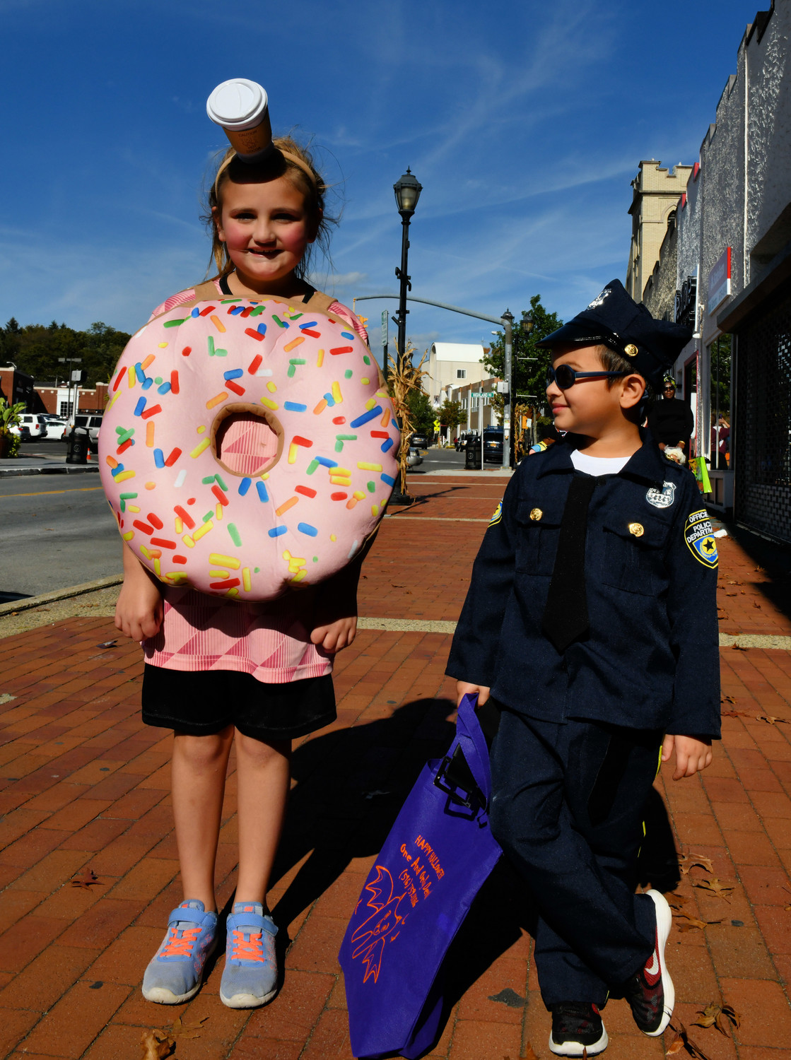 The annual BID Halloween Parade on Saturday was the perfect preview for Tuesday's day of candy. It included all kinds of costumed marchers, including Ella Wohltmann, left, and Desmond Sahai.