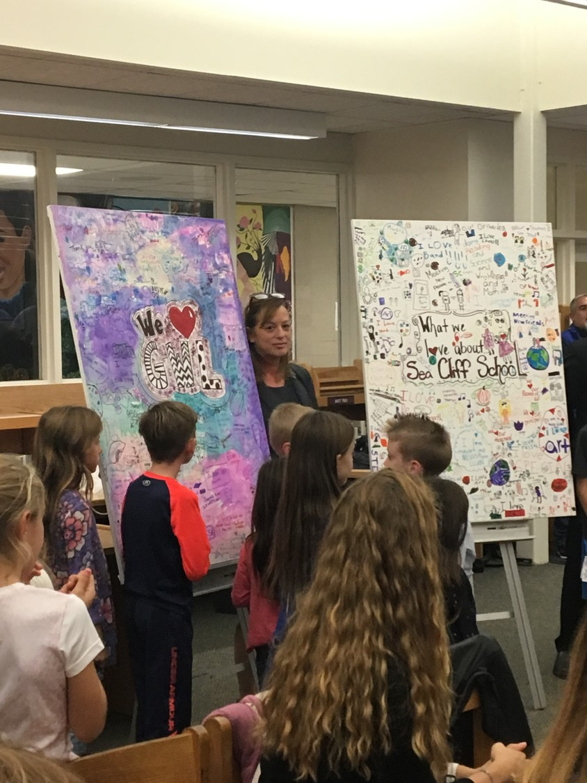 Principal Bridget Finder of the Glenwood Landing School presented a student-made mural to the Board of Education as a gift of appreciation.