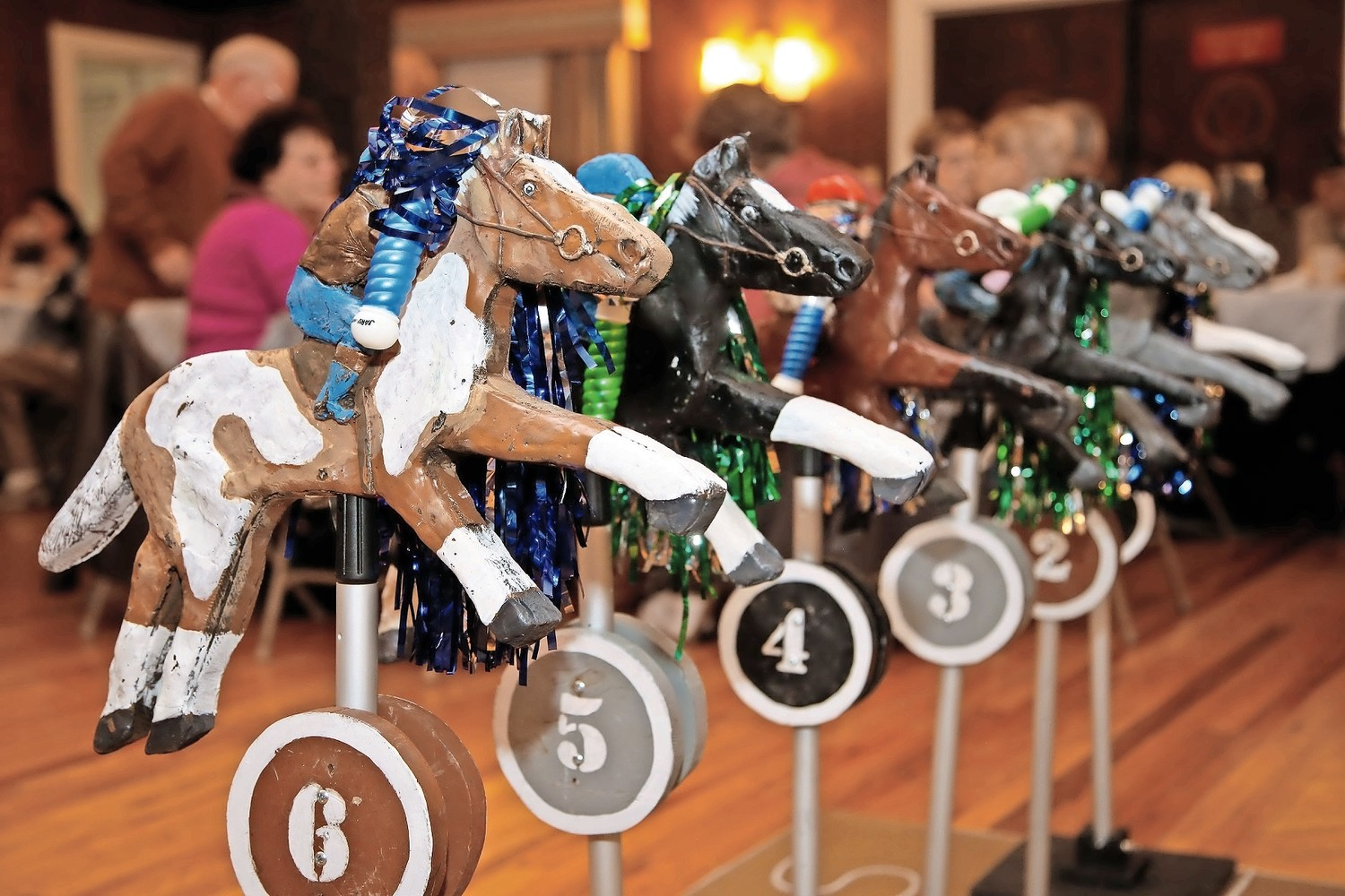 Wooden horses with names like Dragonheart and Mr. Speedy, lined up for some charitable racing at the Malverne American Legion Post 44 on Nov. 4.