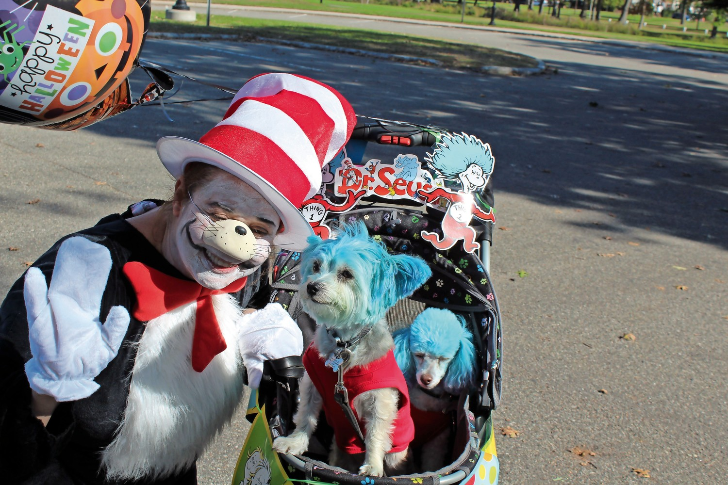 "Linda Troy, of Valley Stream, won first-place in the Best Group Costume category for dressing her dogs up as 'Thing 1' and 'Thing 2' from the Dr. Seuss book ""The Cat in the Hat."""