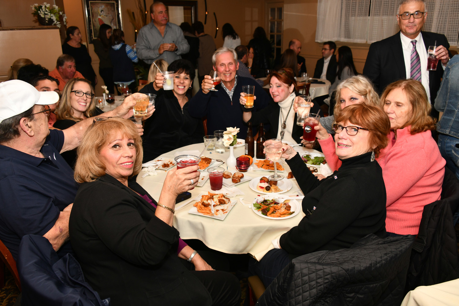 Supporters of the Mayor make a toast at The View Grill on election night.